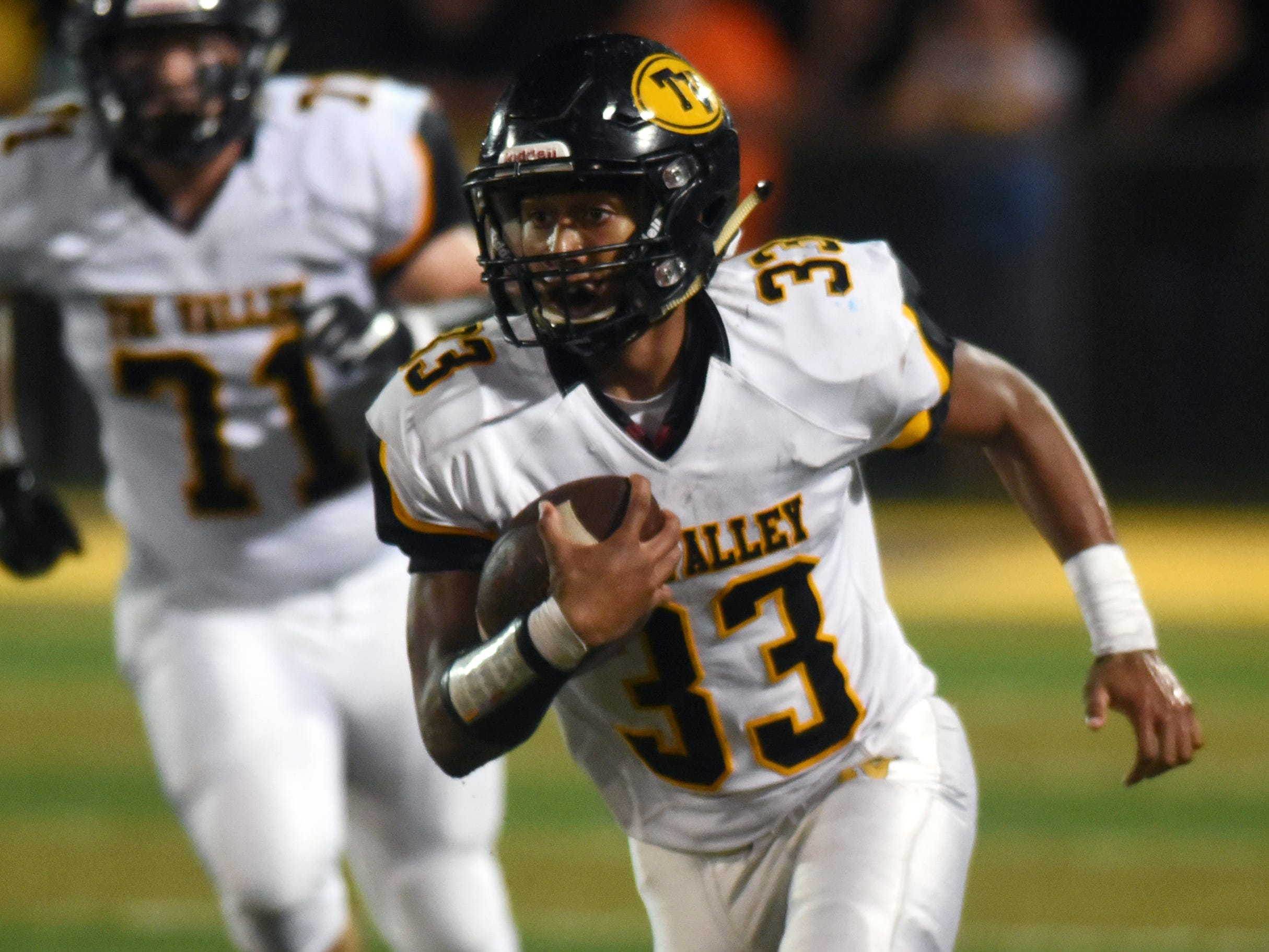 Jordan Pantaleo runs with the ball for Tri-Valley on Friday night against Philo at Sam Hatfield Stadium.