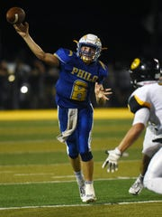 Philo's Hunter Adolph fires a pass to the sideline in the second half against Tri-Valley last season. Adolph returns to quarterback the Electrics, who have high aspirations entering this season.