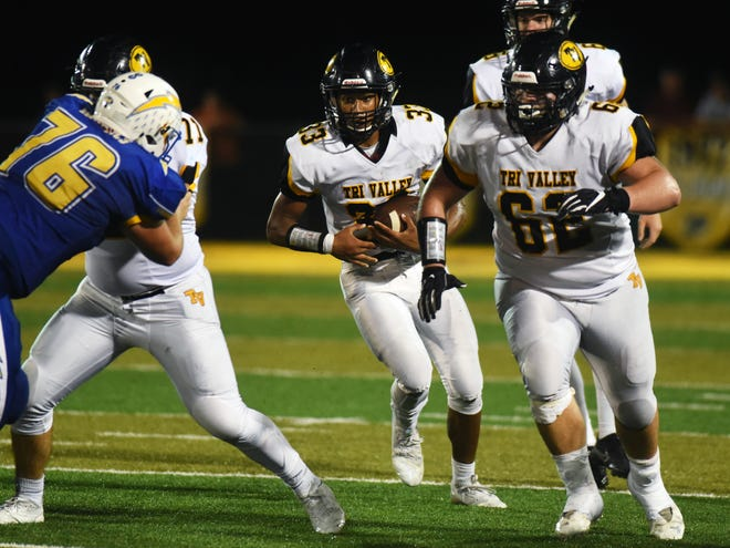 Tri-Valley's Jordan Pantaleo follows senior Garrette Miller during a run in the second quarter against Philo earlier this season. The emergence of the running game is one of several positives for the Scotties, who again enter the postseason as an underdog.