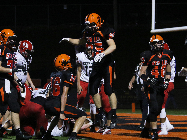 New Lexington's celebrates a touchdown against Coshocton.