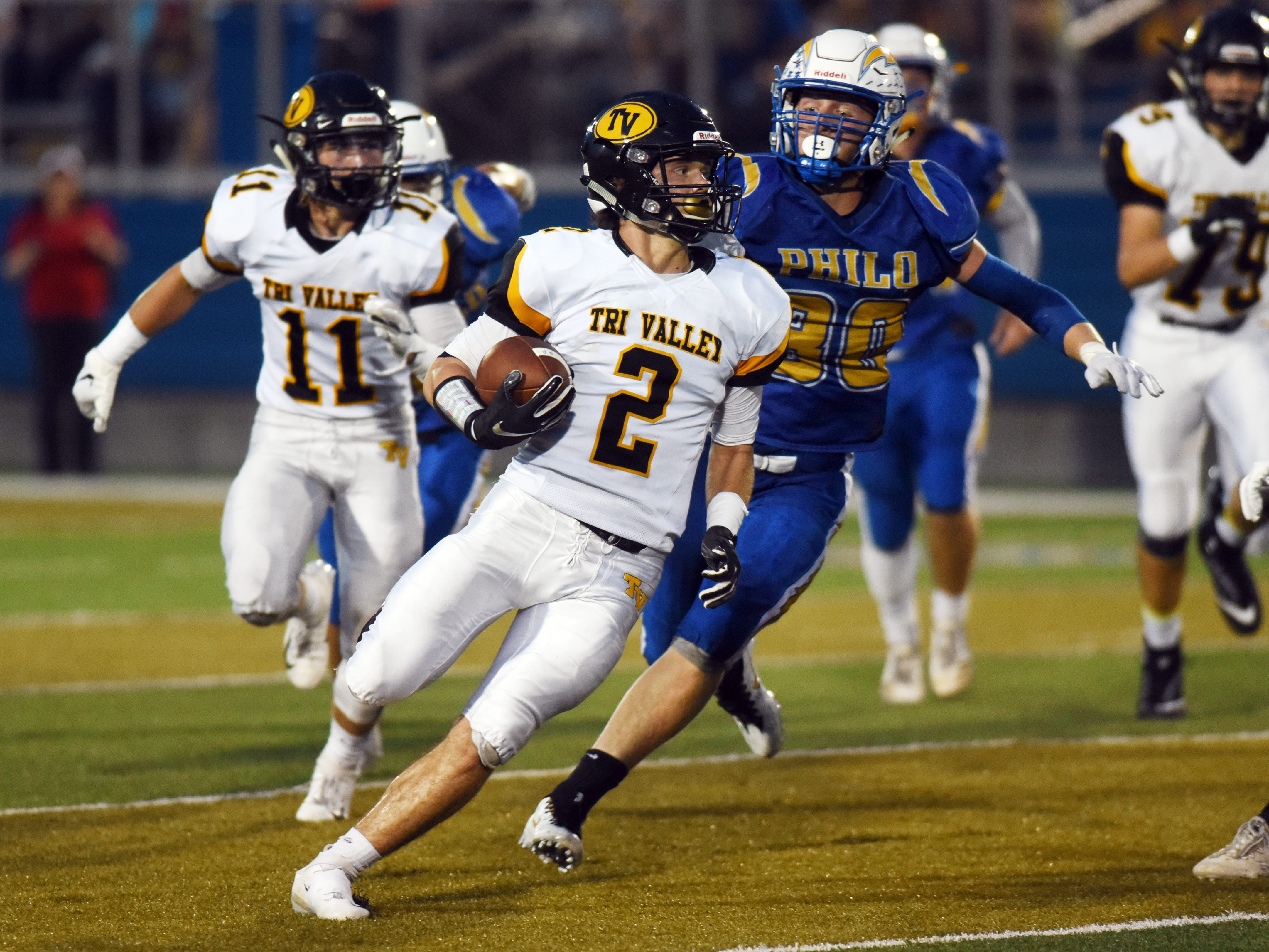 Blayze Taylor, of Tri-Valley, returns a punt for a touchdown against Philo during the second quarter of a 28-14 win on Friday night at Sam Hatfield Stadium.