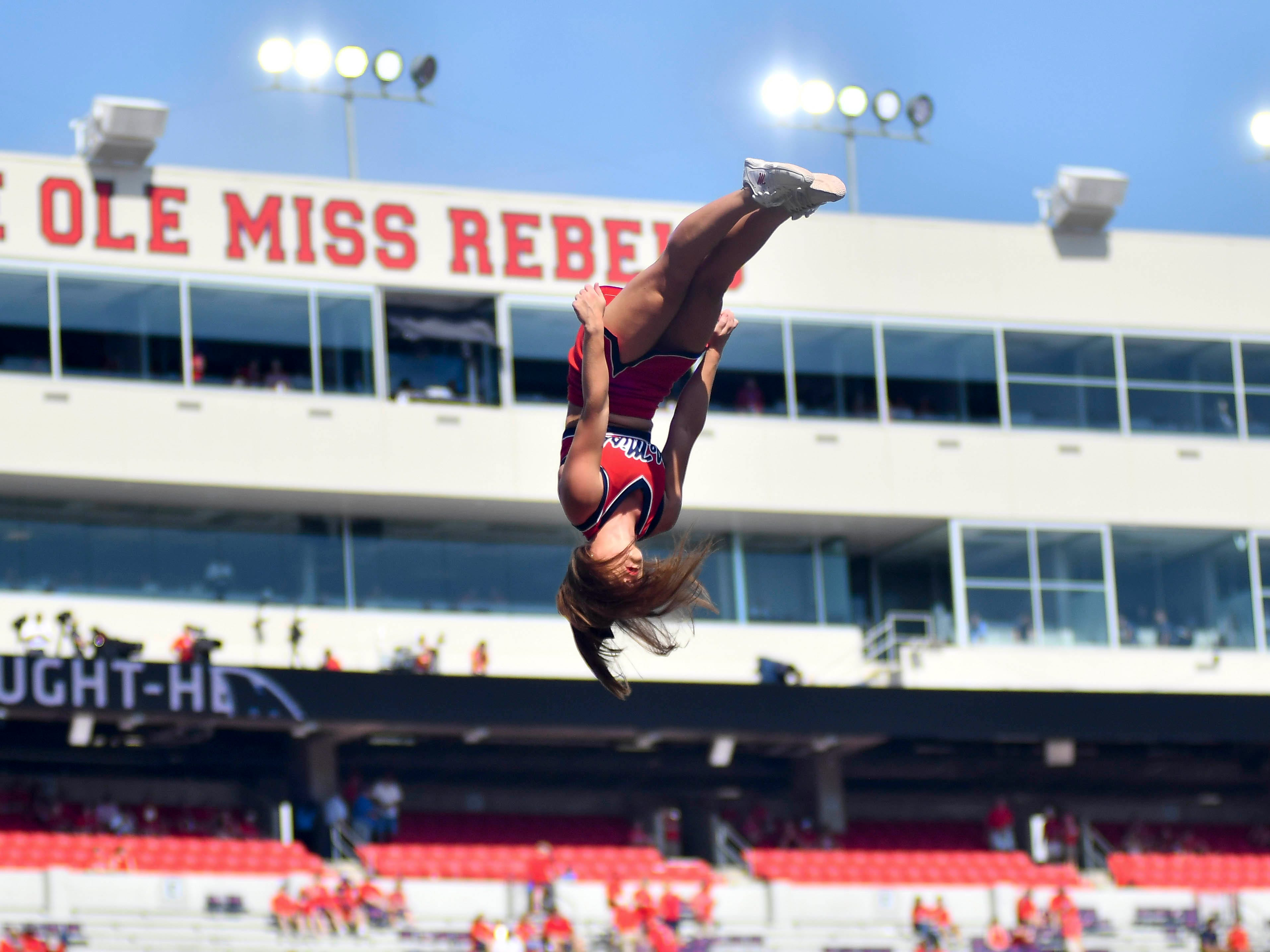 An Ole Miss cheerleader performs before the game against Kent State at Vaught-Hemingway Stadium.