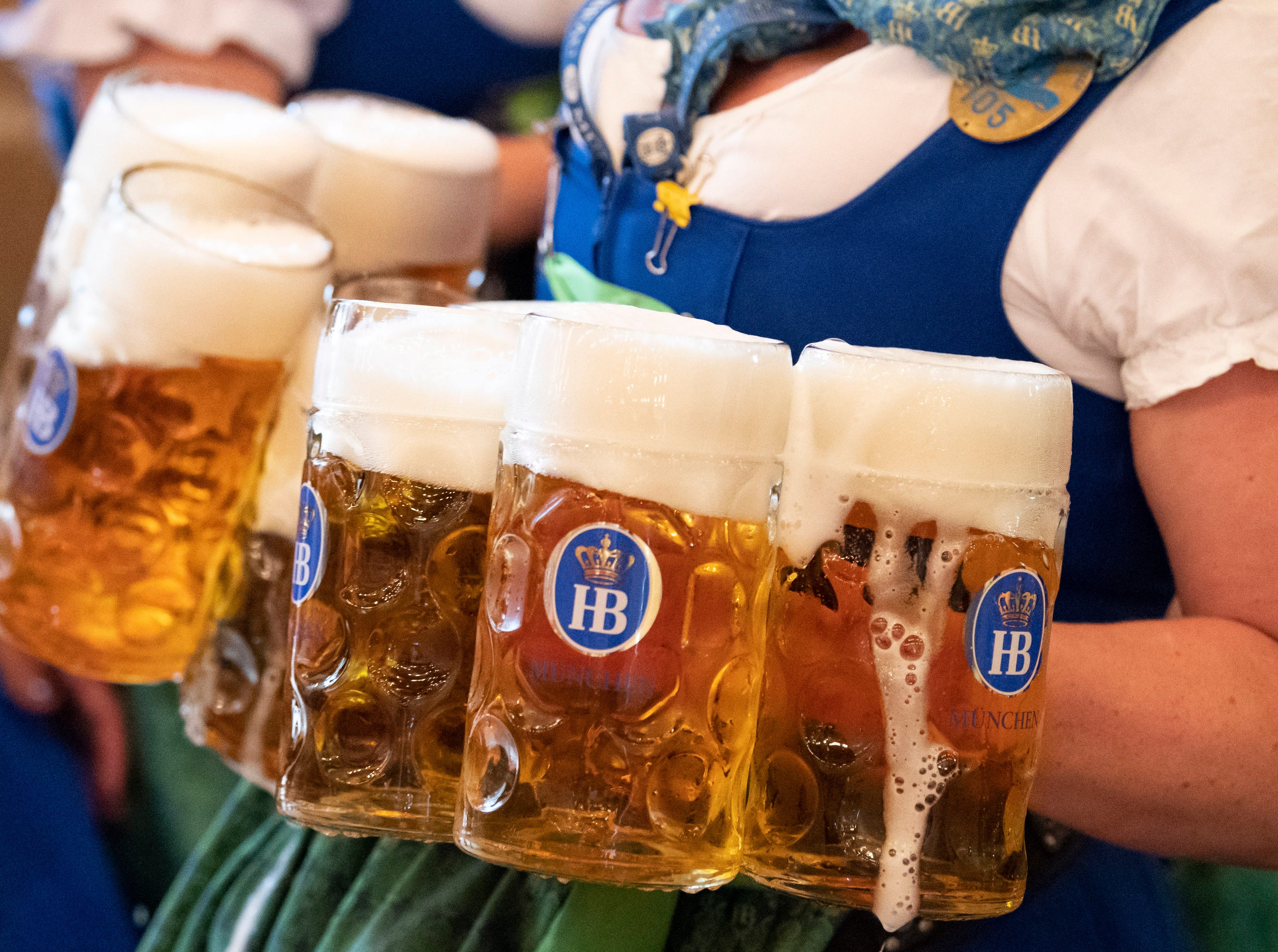 A waitress carries mugs of beer during the opening day Oktoberfest.