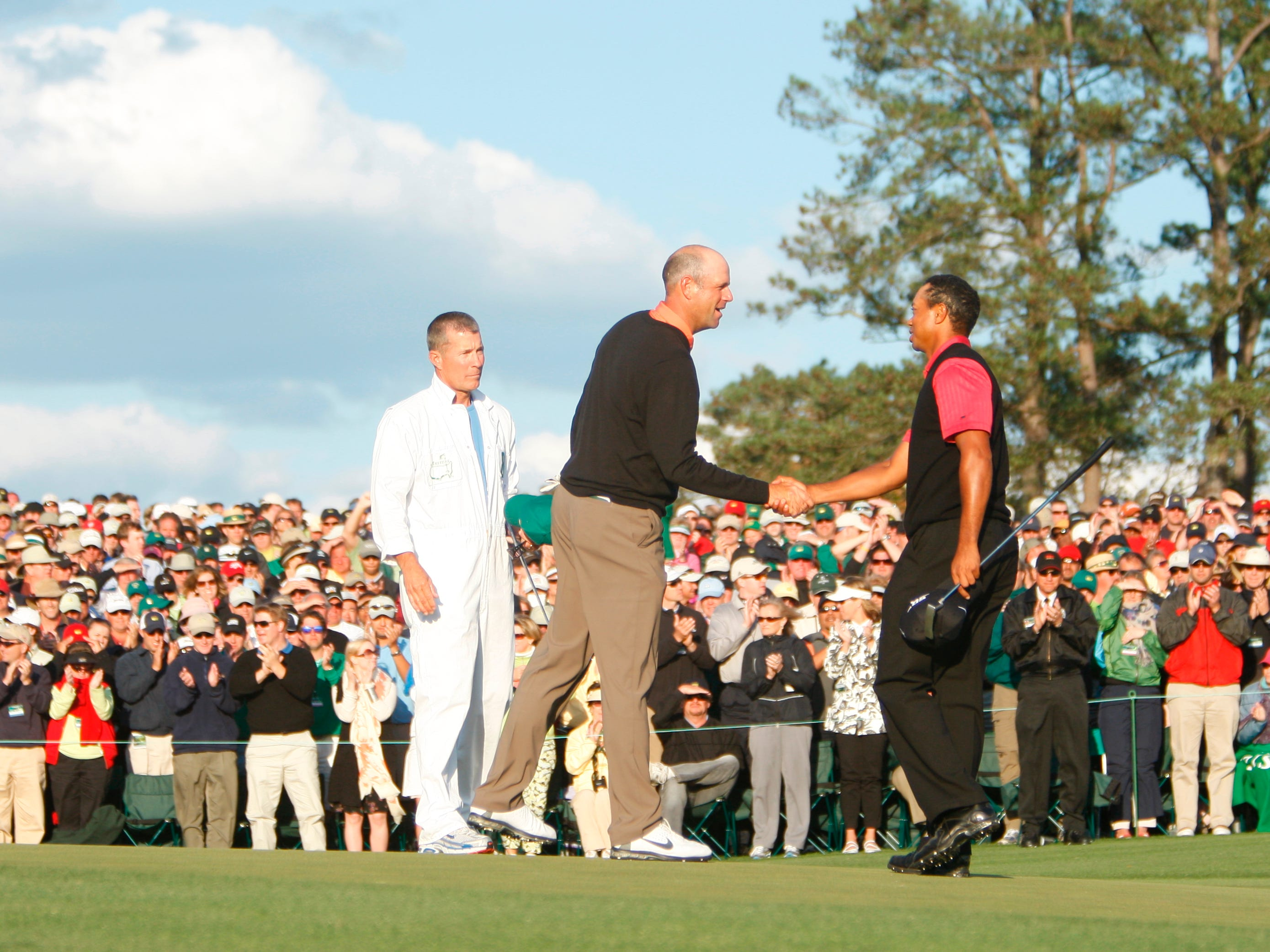 Two days after a runner-up finish at the Masters, Tiger Woods has arthroscopic surgery to repair cartilage damage. Here he's shown at the Masters with Stewart Cink.