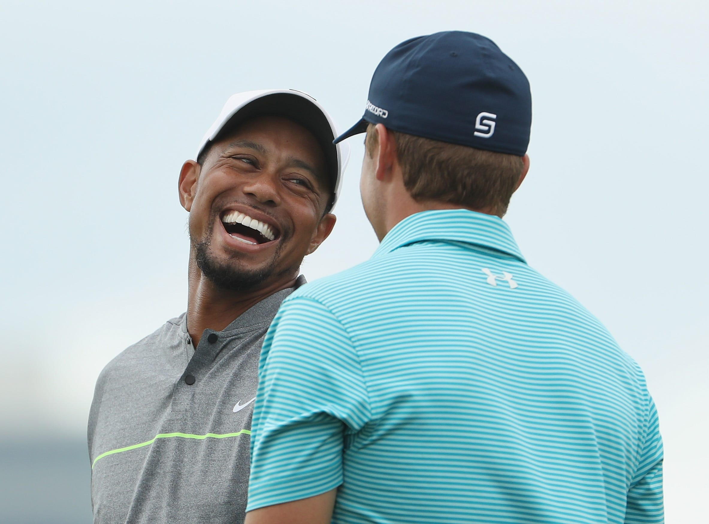 In December 2016, Woods competes for the first time in 15 months at the Hero World Challenge in the Bahamas. Here he's shown with Jordan Spieth.