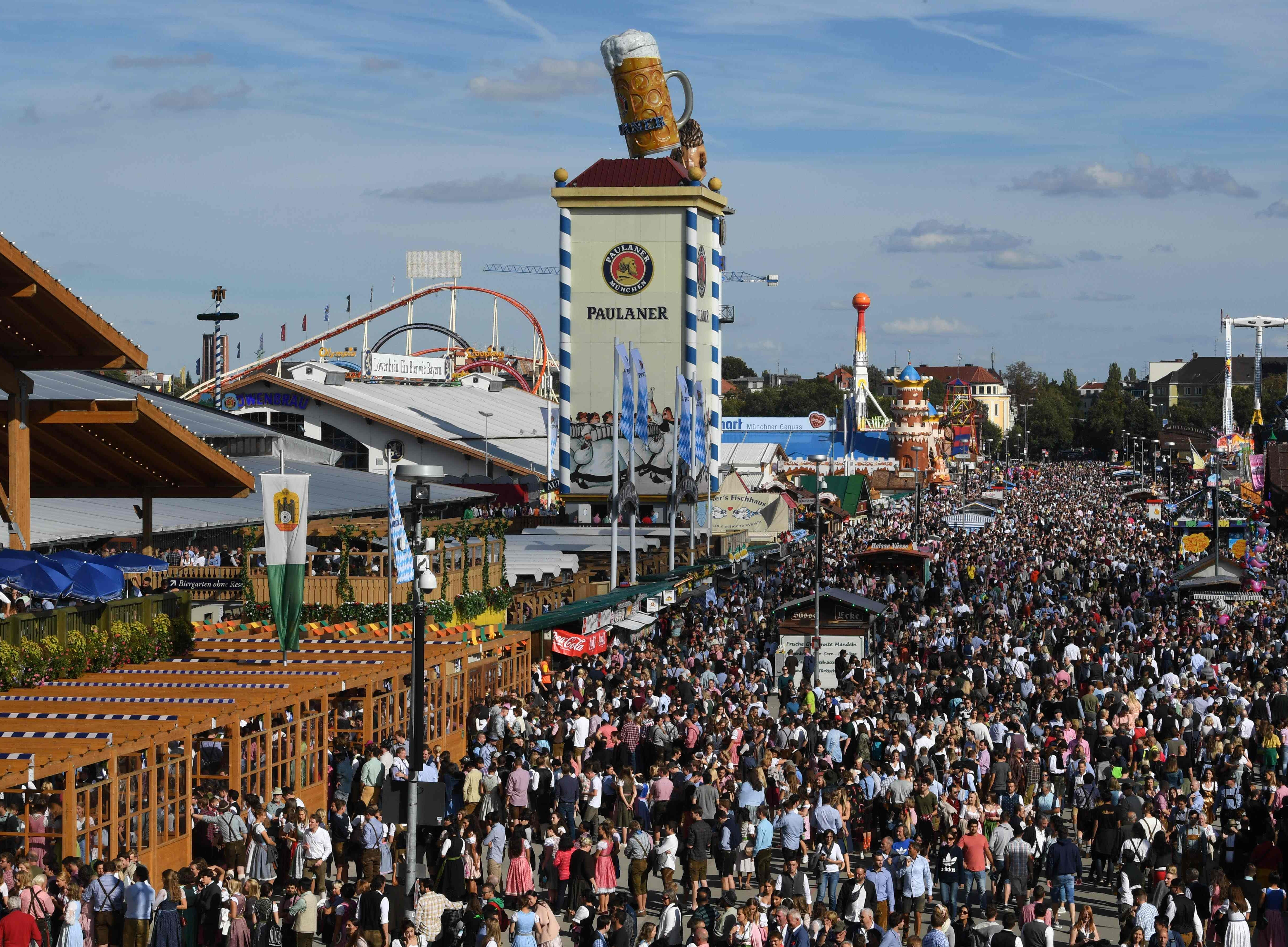 Visitors walk at the Theresienwiese fair ground.