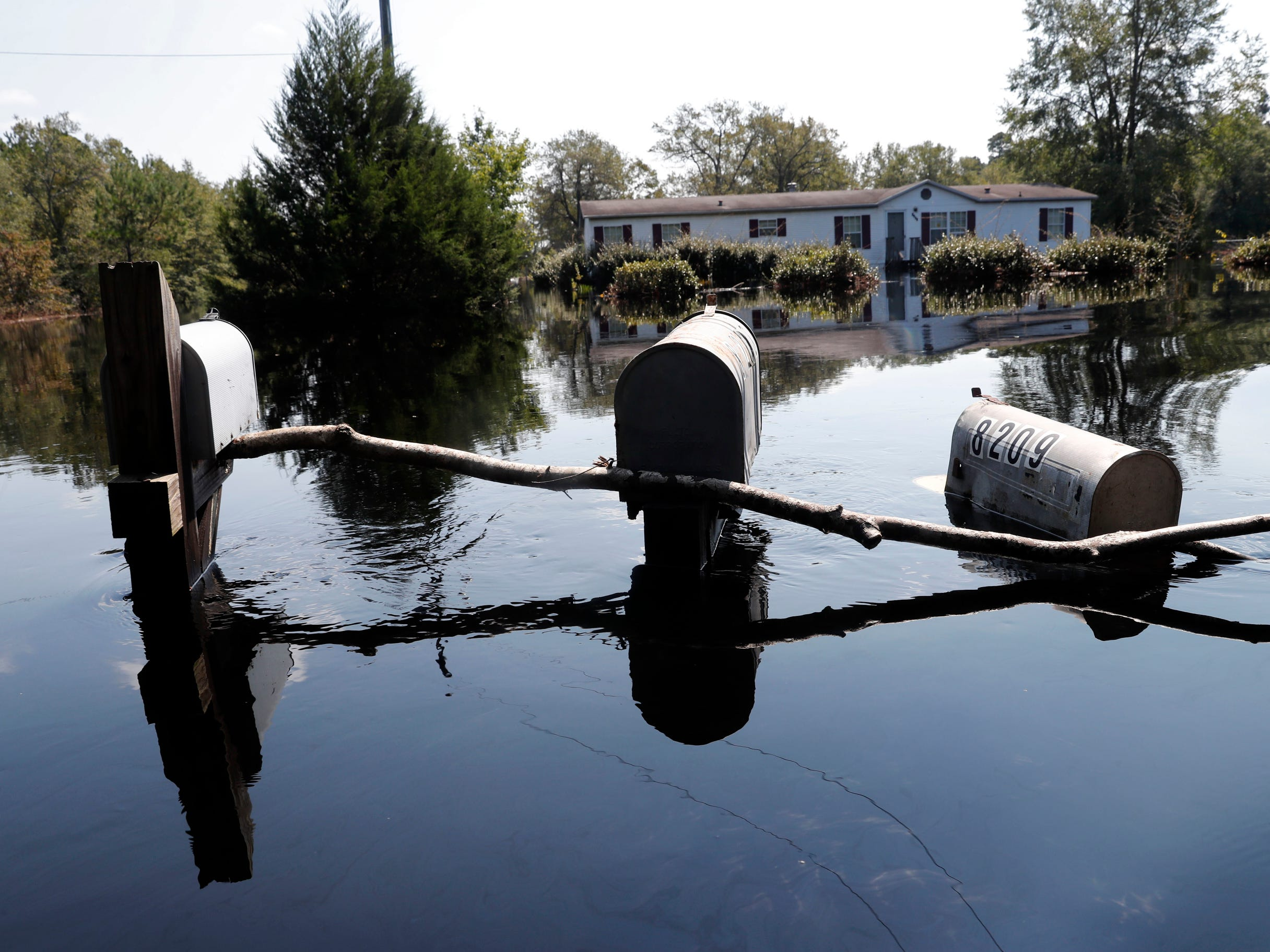 Rows of mailbox protrude through floodwaters in the aftermath of Hurricane Florence in Nichols, S.C., Friday, Sept. 21, 2018. Virtually the entire town is flooded and inaccessible except by boat, just two years after it was flooded by Hurricane Matthew.
