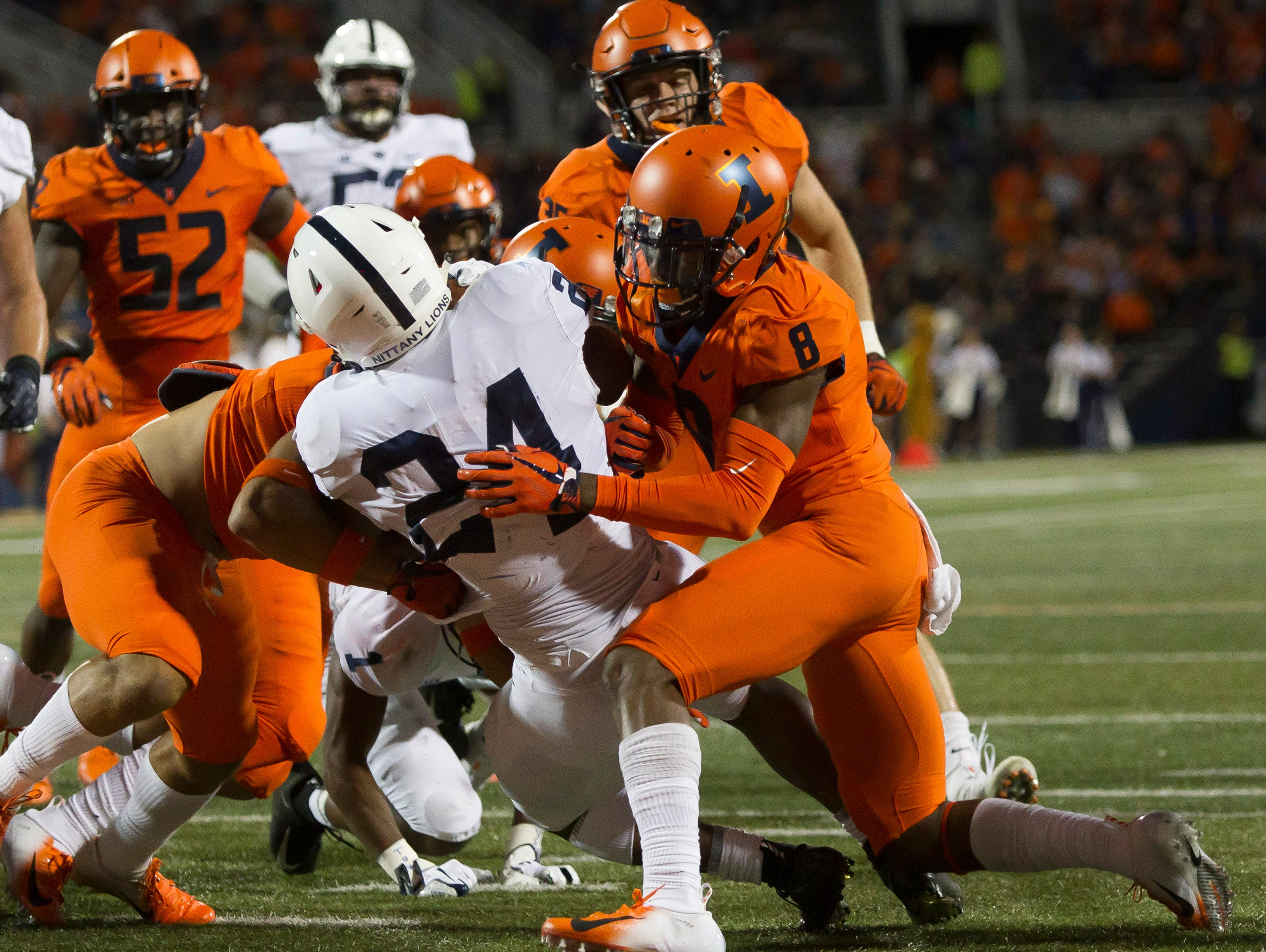 Illinois Fighting Illini defensive back Nate Hobbs (8) is unable to keep Penn State Nittany Lions running back Miles Sanders (24) from crossing the goal line during the first quarter at Memorial Stadium.