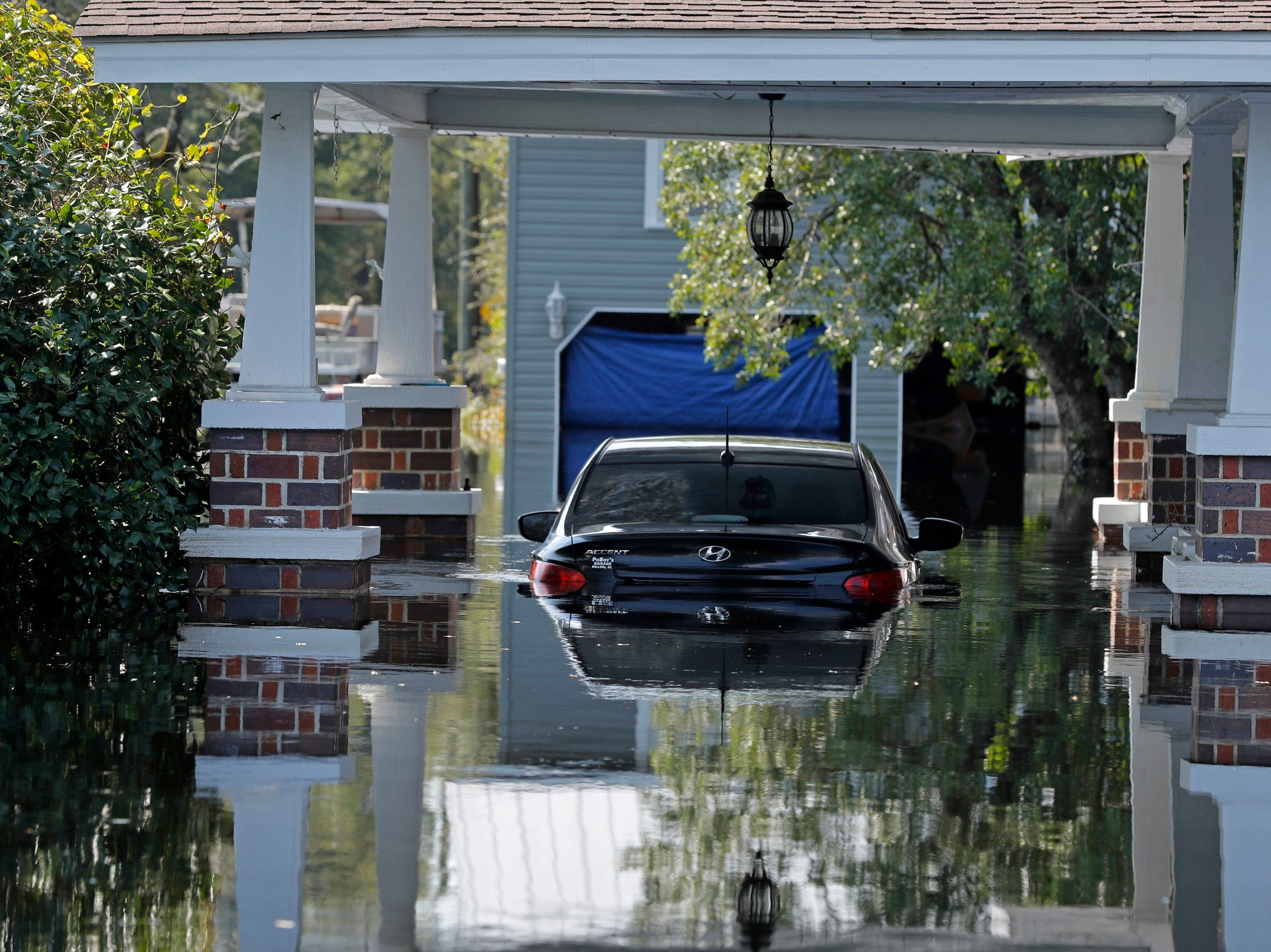 A submerged car sits in floodwaters in the aftermath of Hurricane Florence in Nichols, S.C., Friday.