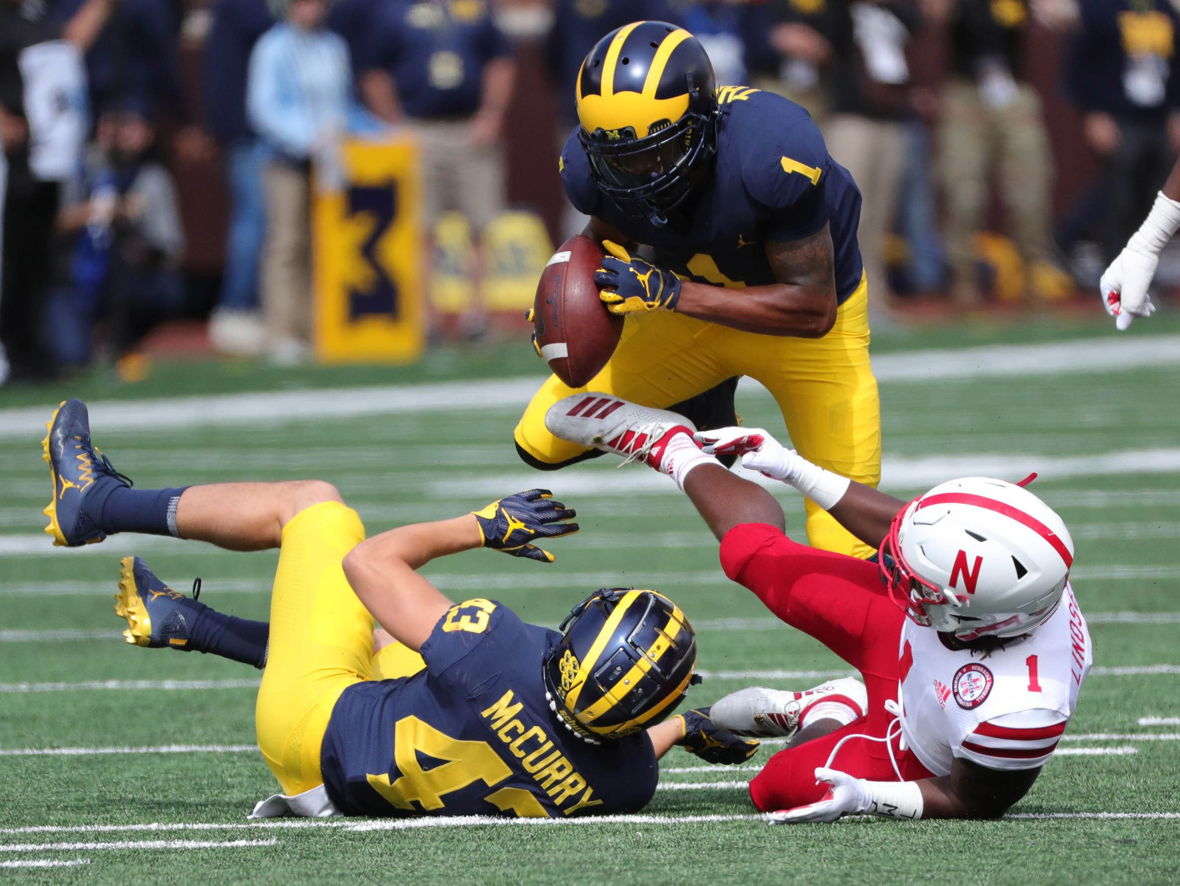 Michigan defensive back Ambry Thomas recovers a fumble by Nebraska receiver Tyjon Lindsey at Michigan Stadium.