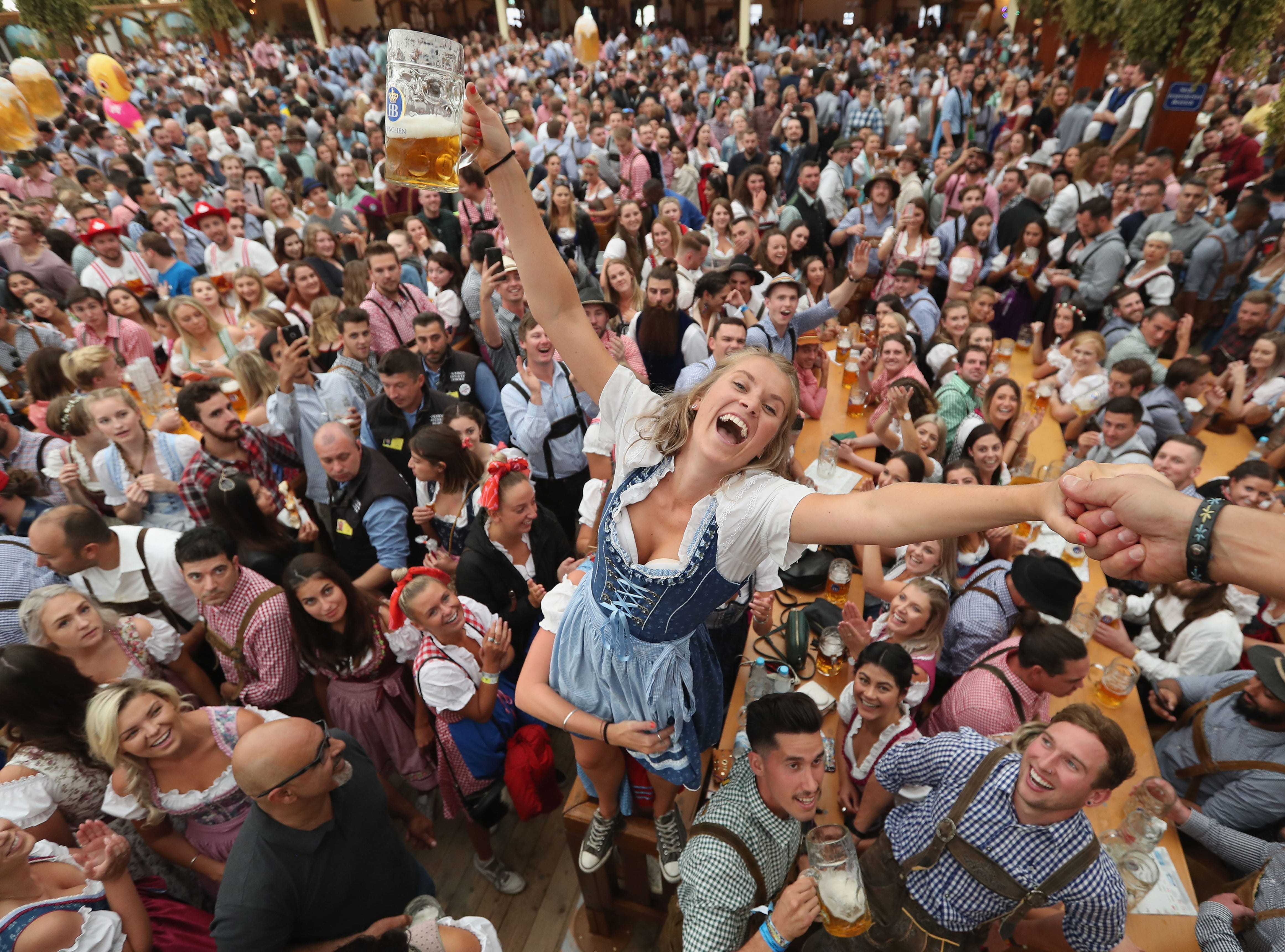 Visitors celebrate in a beer tent on opening day.