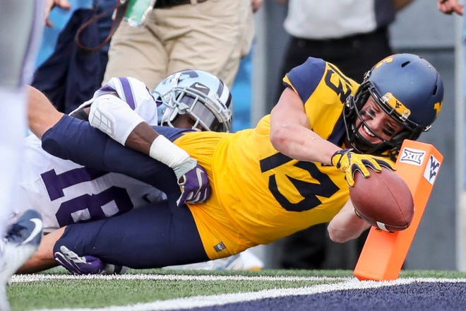 West Virginia Mountaineers wide receiver David Sills V (13) attempts to dive for a touchdown during the third quarter against the Kansas State Wildcats at Mountaineer Field at Milan Puskar Stadium.