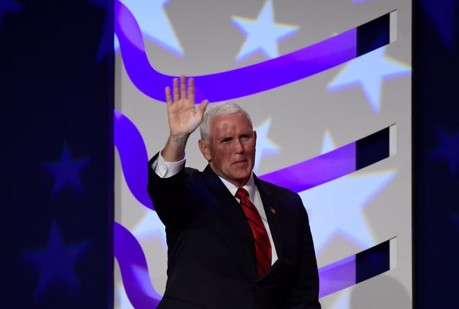 Vice President Mike Pence waves to the audience after speaking at the 2018 Values Voter Summit in Washington, Saturday, Sept. 22, 2018.