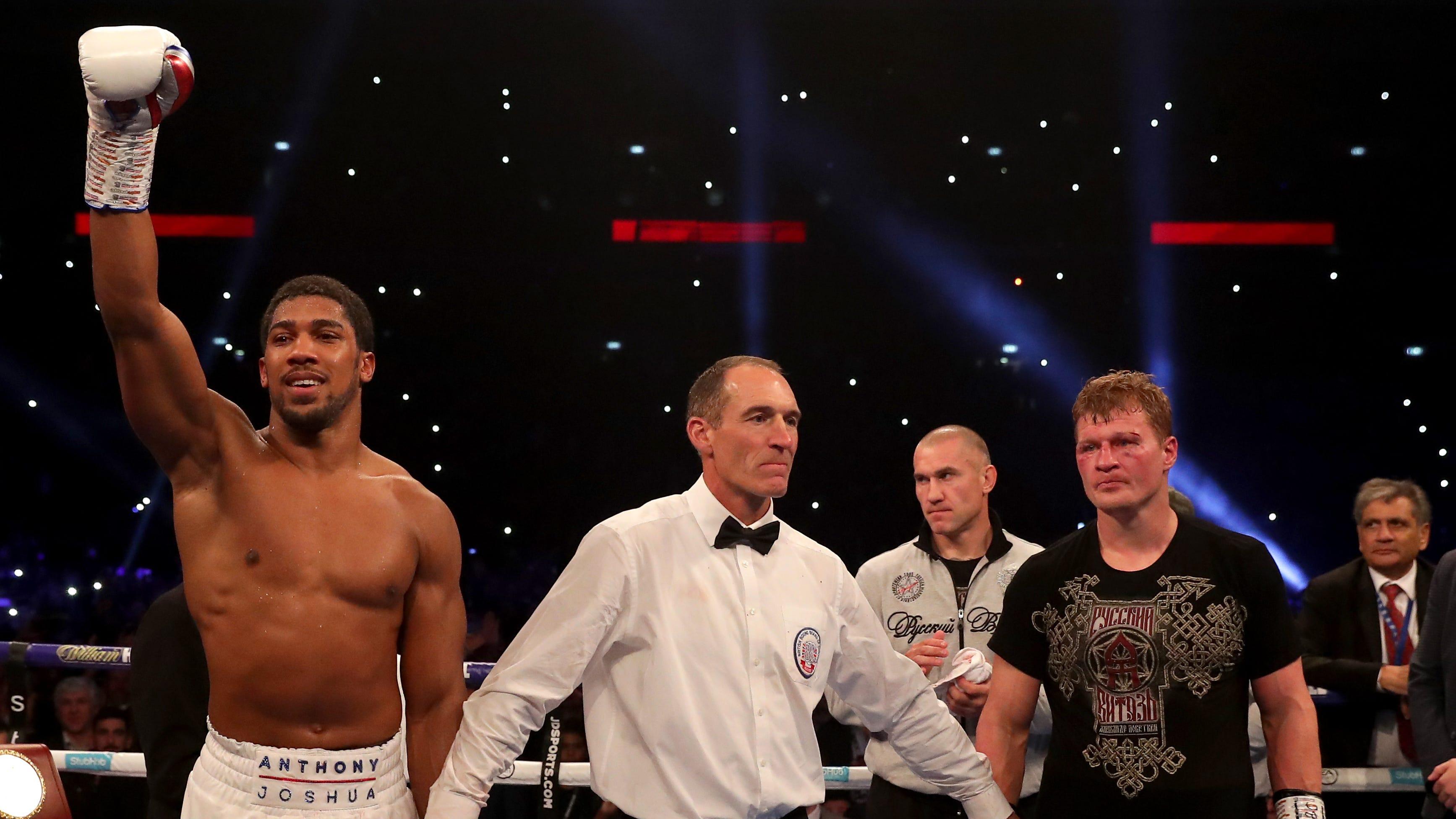 Anthony Joshua celebrates victory against Alexander Povetkin.