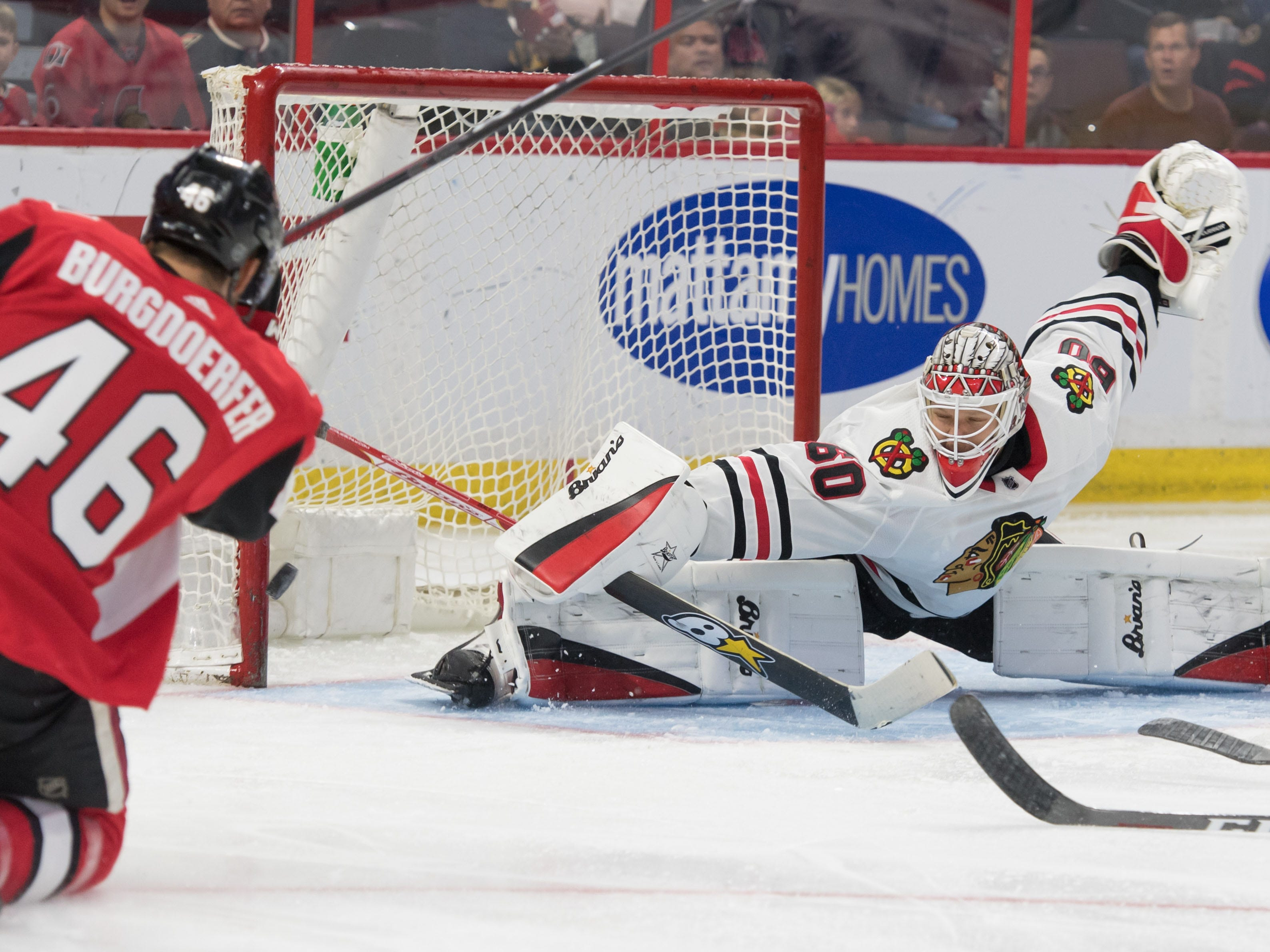 Sept. 21: Chicago Blackhawks goalie Collin Delia stretches to make a save on a shot from Ottawa Senators defenseman Eric Burgdoerfer.