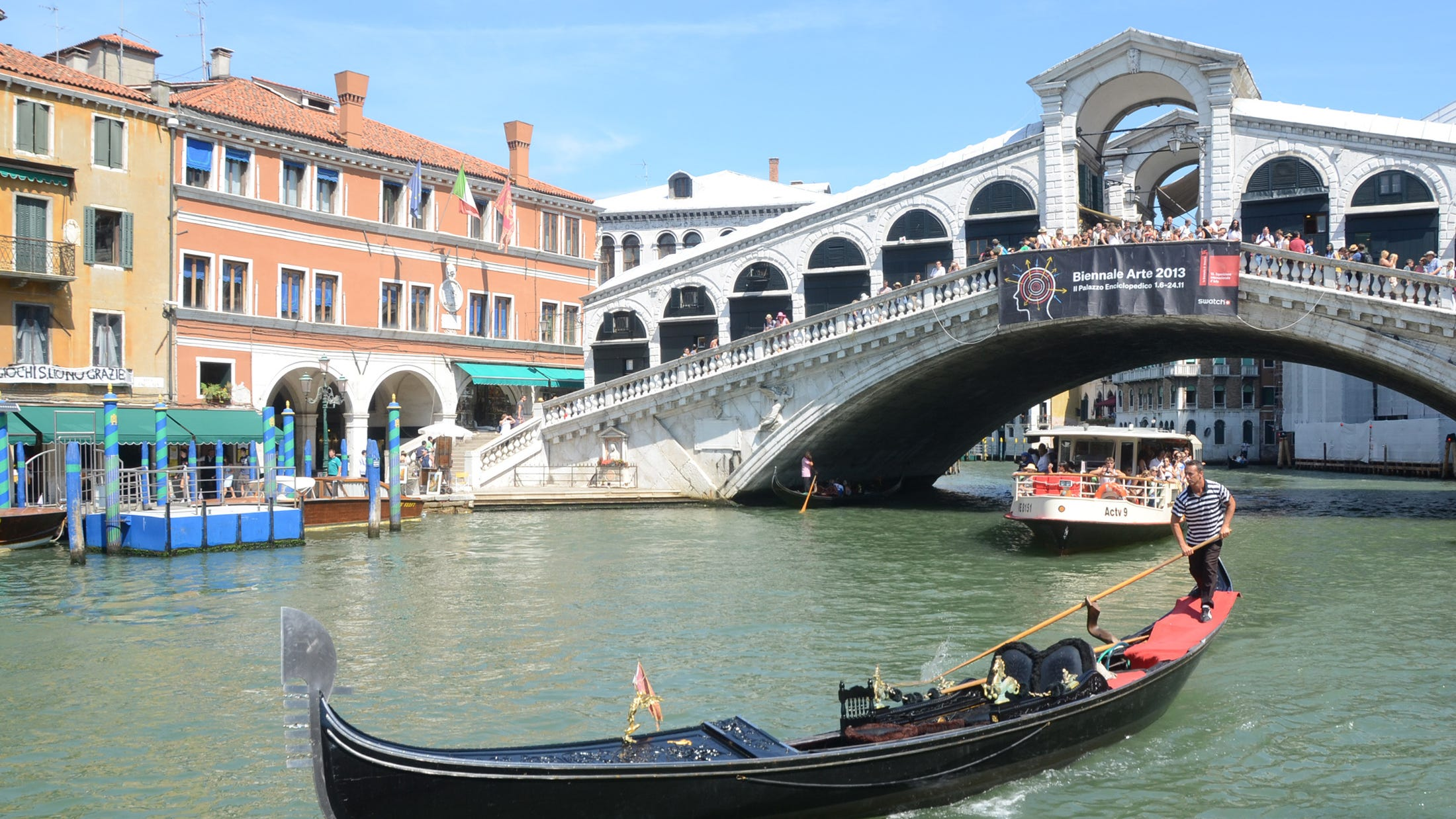 A gondola plies the waters of Venice's Grand Canal, Italy on Aug. 17, 2013.