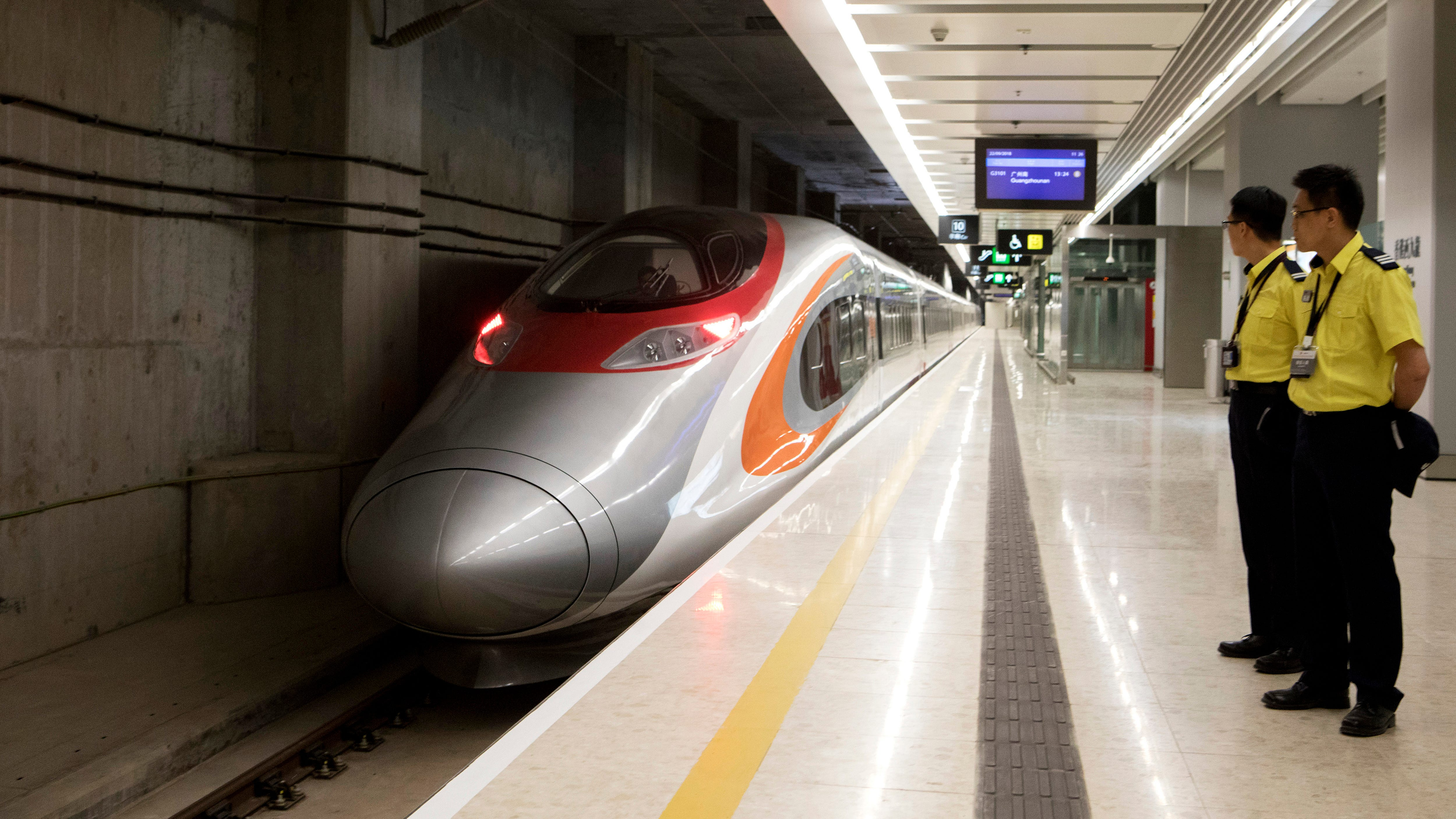 Hong Kong's bullet train to China opens despite controversy, travels 120 mph to mainland
