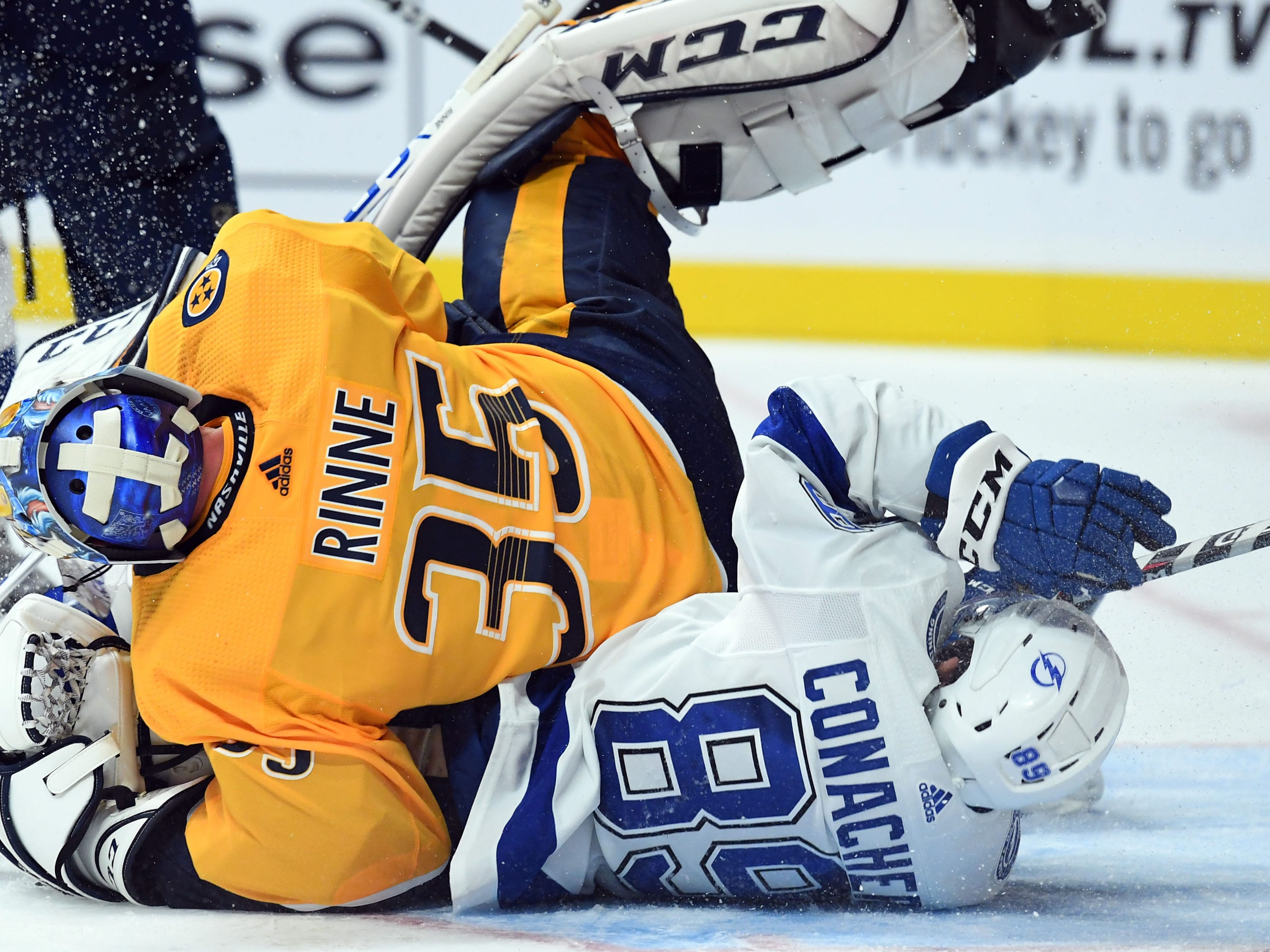 Sept. 21: Tampa Bay Lightning center Cory Conacher is hit into Nashville Predators goaltender Pekka Rinne.