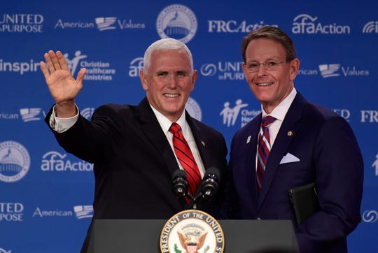 Vice President Mike Pence, left, stand with Family Research Council President Tony Perkins, right before speaking at the 2018 Values Voter Summit in Washington, Saturday, Sept. 22, 2018.
