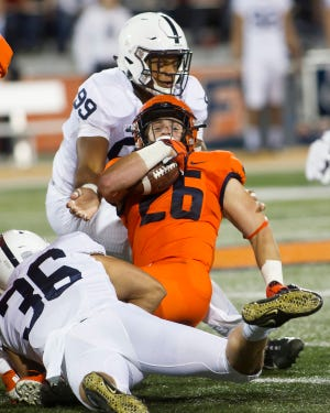 Illinois Fighting Illini running back Mike Epstein (26) is tackled by Penn State Nittany Lions defensive end Yetur Gross-Matos (99) during the first quarter at Memorial Stadium.