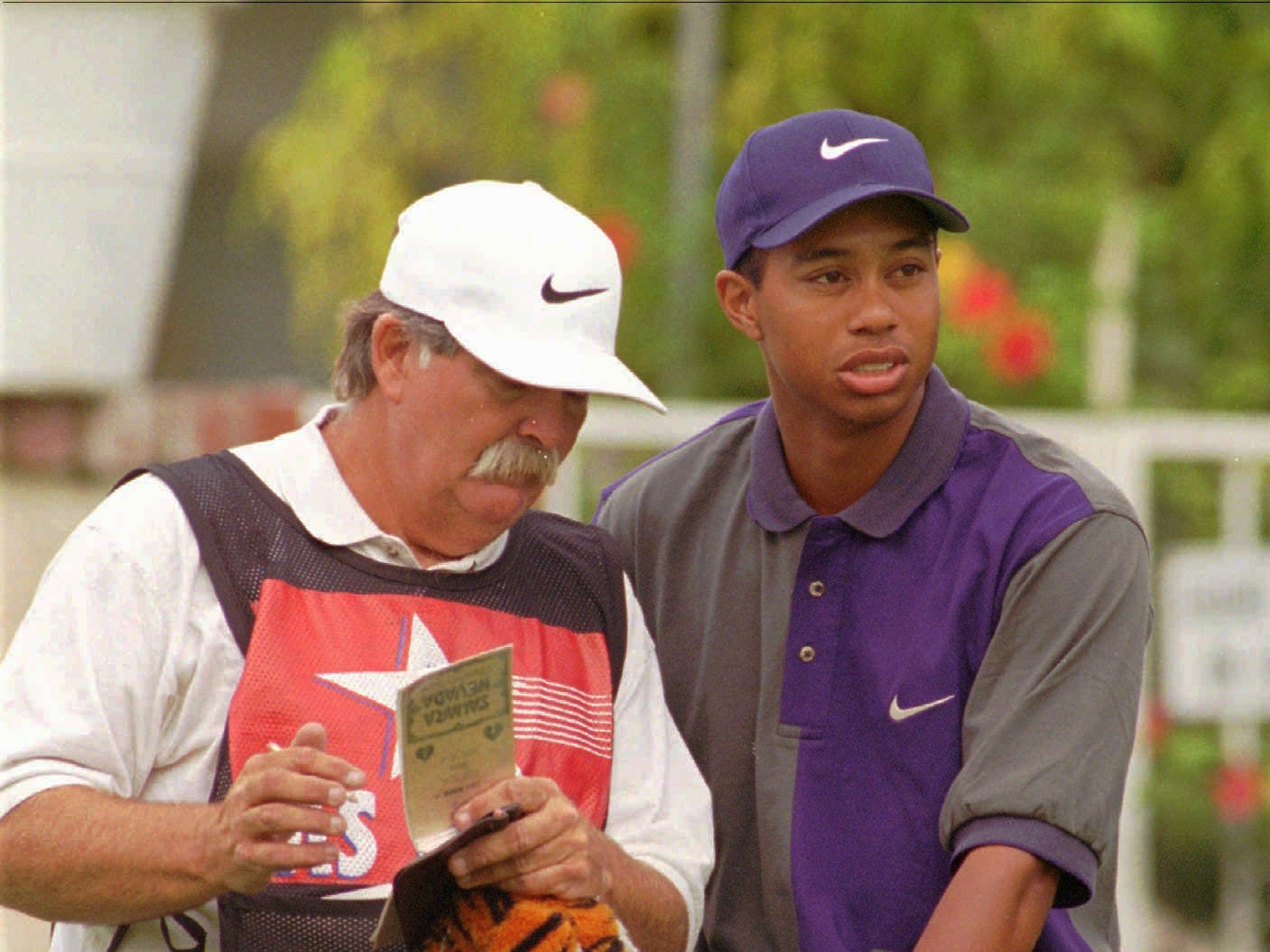 "With Mike ""Fluff"" Cowan on the bag in October 1996, Tiger Woods won the  Las Vegas Invitational for his first PGA Tour victory."