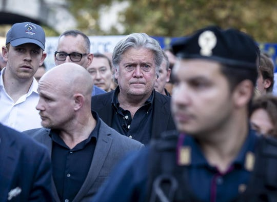 Former White House strategist Steve Bannon, center, arrives for the Atreju 18 political meeting, the youth festival of the right-wing Brothers of Italy party in Rome.