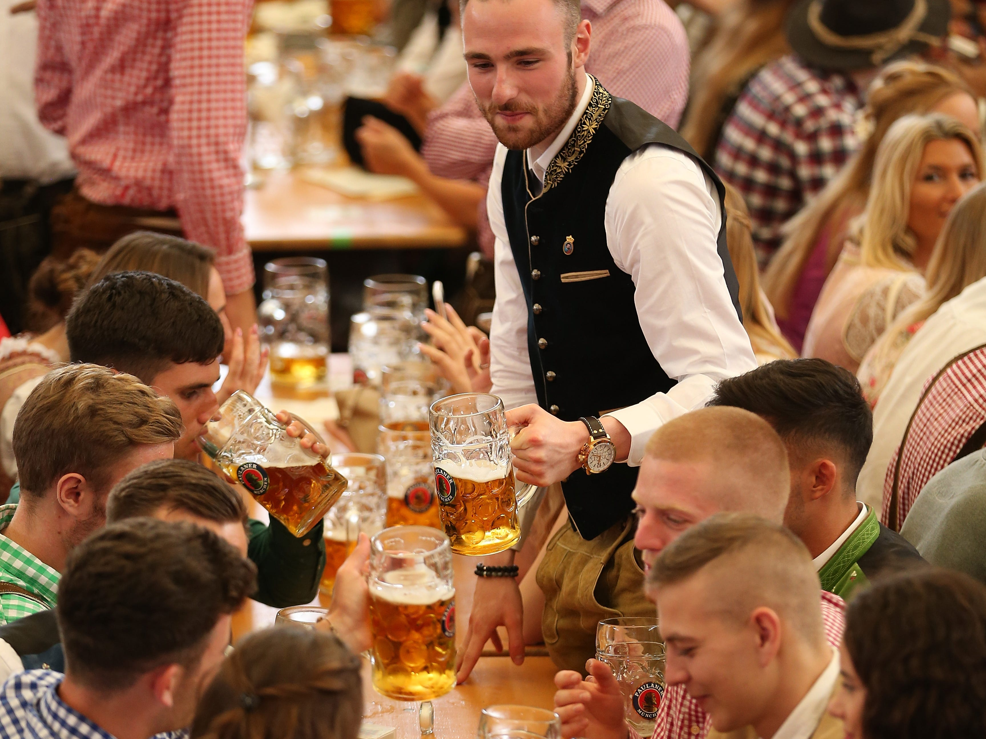 Revelers celebrate in the Paulaner tent shortly after the official opening of the 2018 Oktoberfest beer festival.