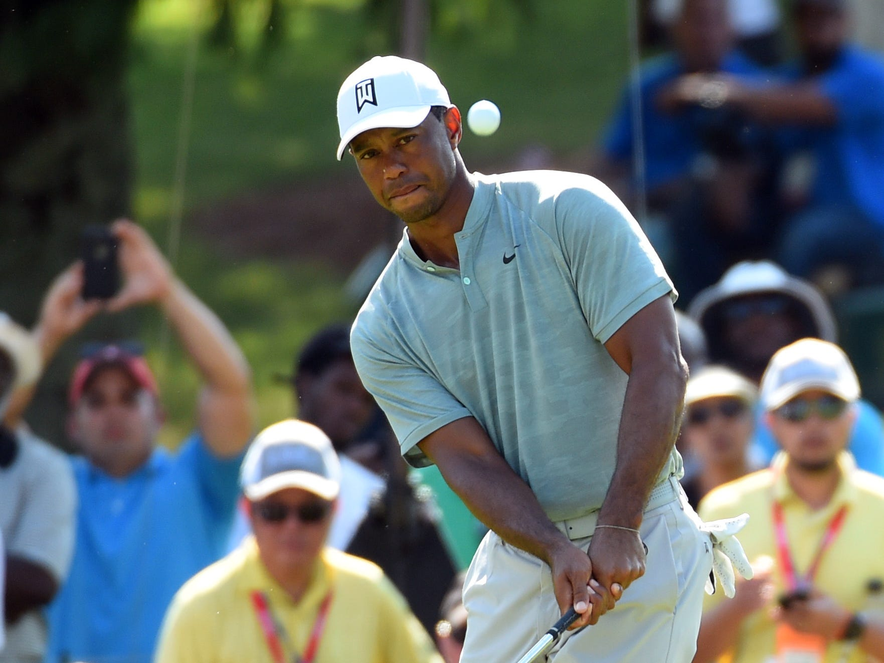 Tiger Woods chips on the 11th green during the second round of the Tour Championship golf tournament at East Lake Golf Club.