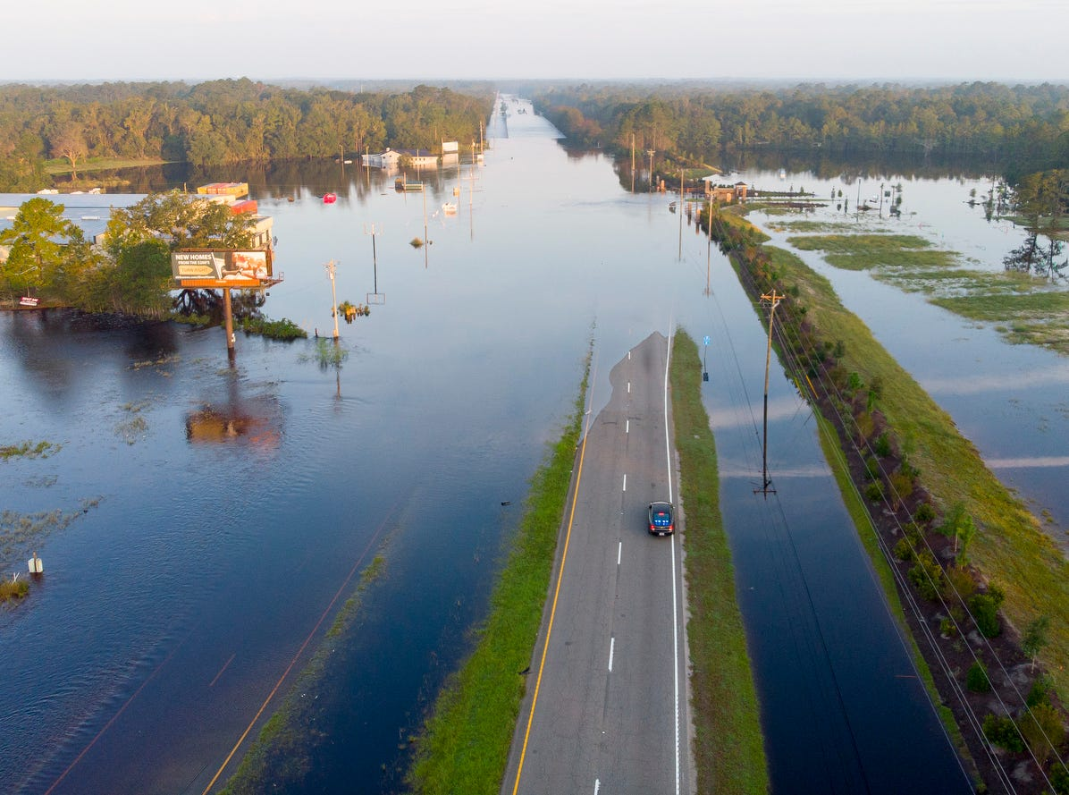 The Waccamaw River overflows it's banks at Highway 9, Friday, in Conway, S.C.