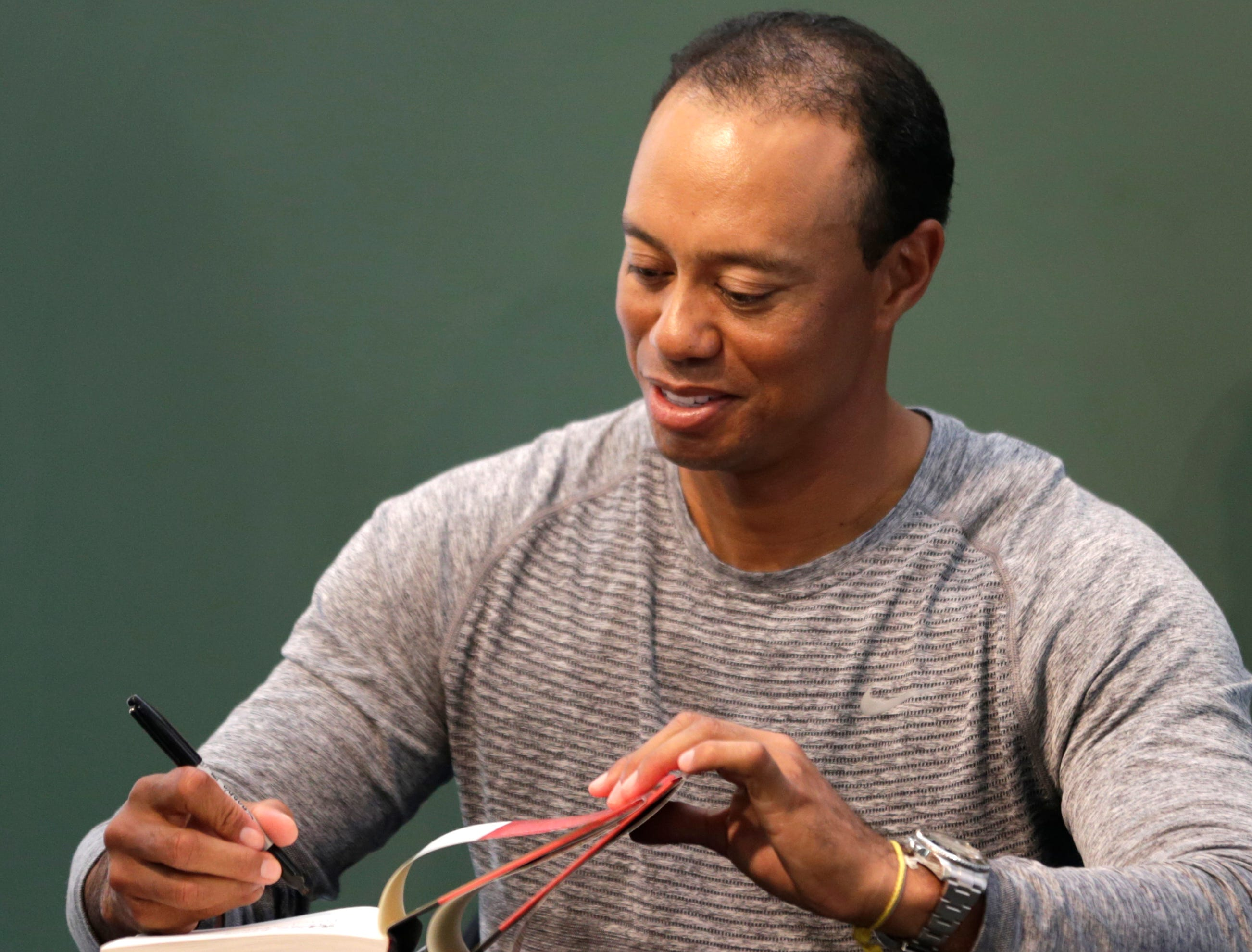 In April 2017, Woods has his fourth back surgery to fuse discs in his lower back. He would make only one PGA Tour start that season. Here he's shown signing copies of his new book in New York.