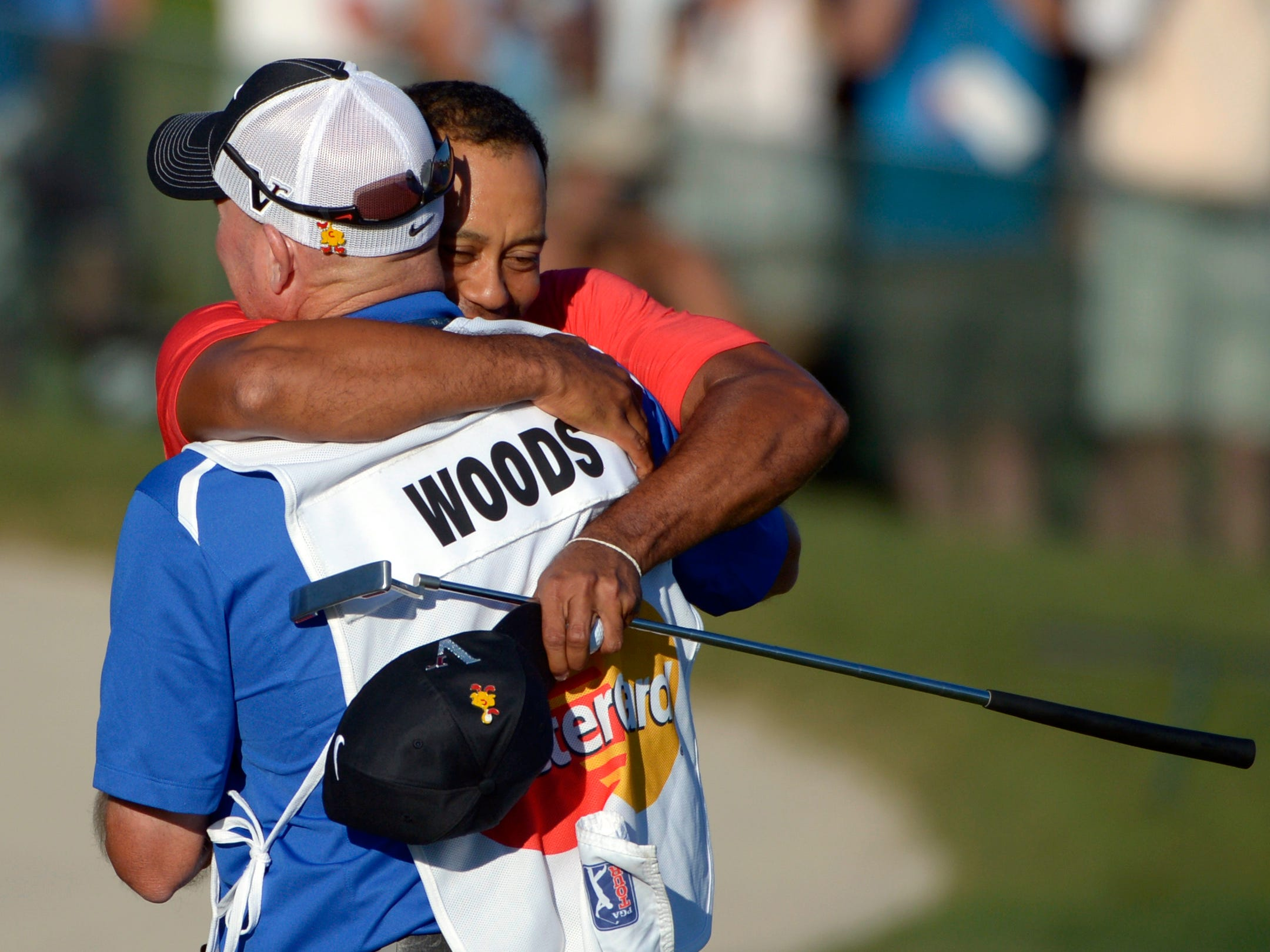 Woods wins the Arnold Palmer Invitational in March 2012 for his first PGA Tour victory since the scandal in his personal life. Here he hugs his caddie Joe LaCava.