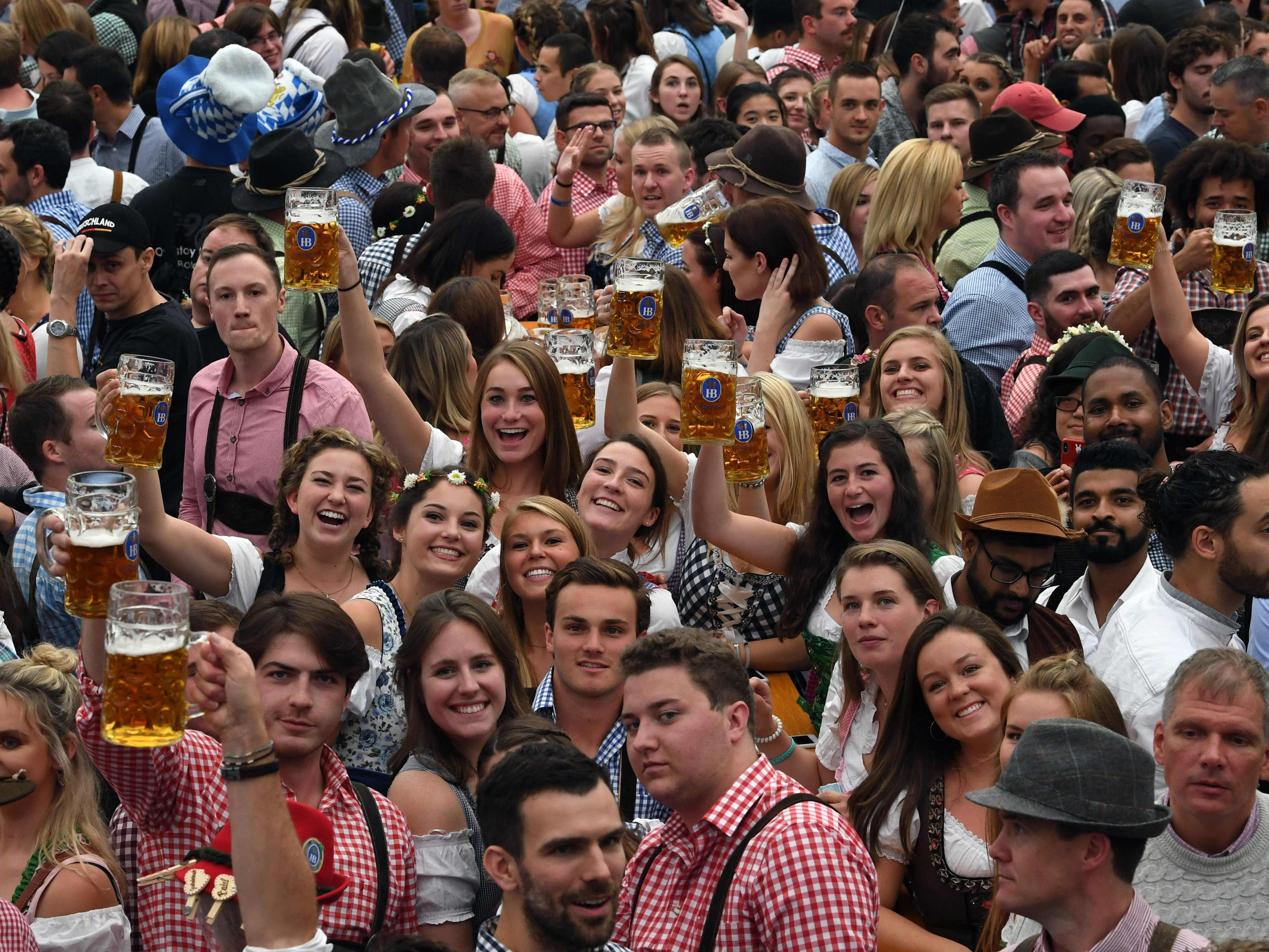 Prost! Festival-goers lift their glasses for a photo.