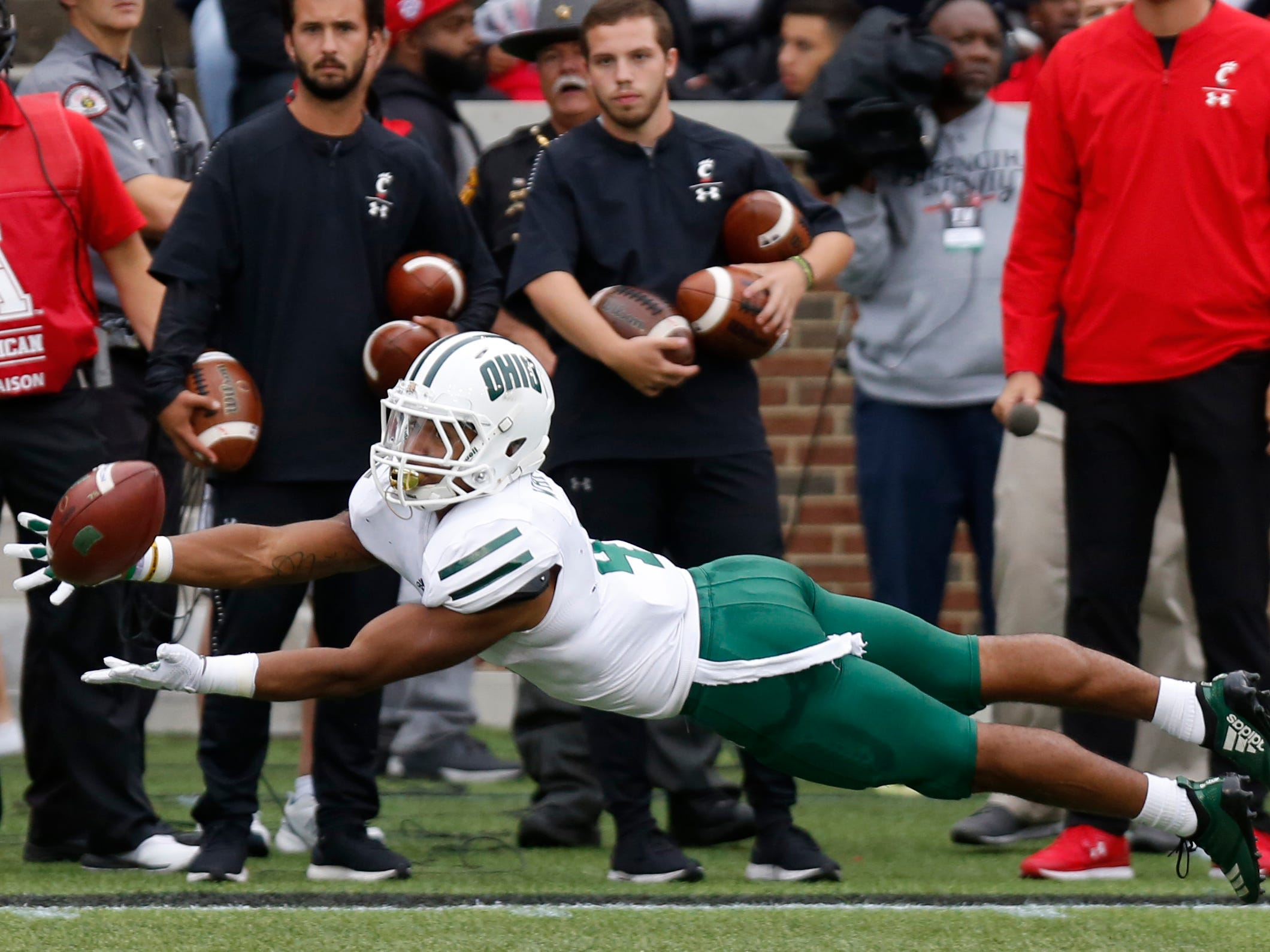 Ohio Bobcats wide receiver Papi White dives for the ball against the Cincinnati Bearcats during the first half at Nippert Stadium.