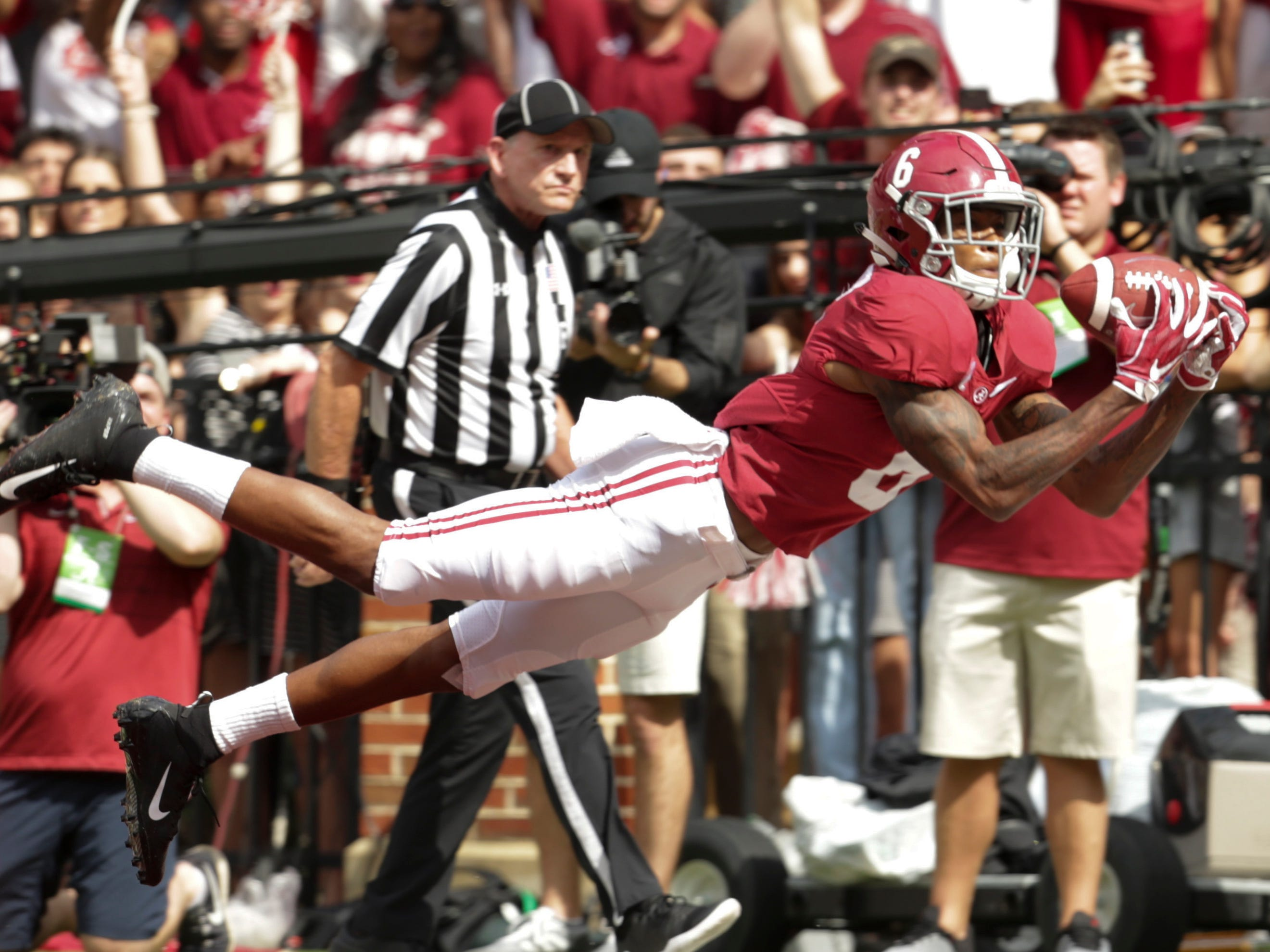 Alabama Crimson Tide wide receiver DeVonta Smith catches a pass for a touchdown against Texas A&M Aggies at Bryant-Denny Stadium.