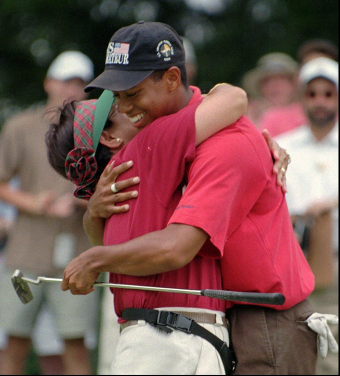 Tiger Woods is embraced by his mother, Kultilda, after winning his third U.S. Amateur on Aug. 25, l996, at  Pumpkin Ridge Golf Club in North Plains, Ore. Woods defeated Steve Scott on the 38th hole.
