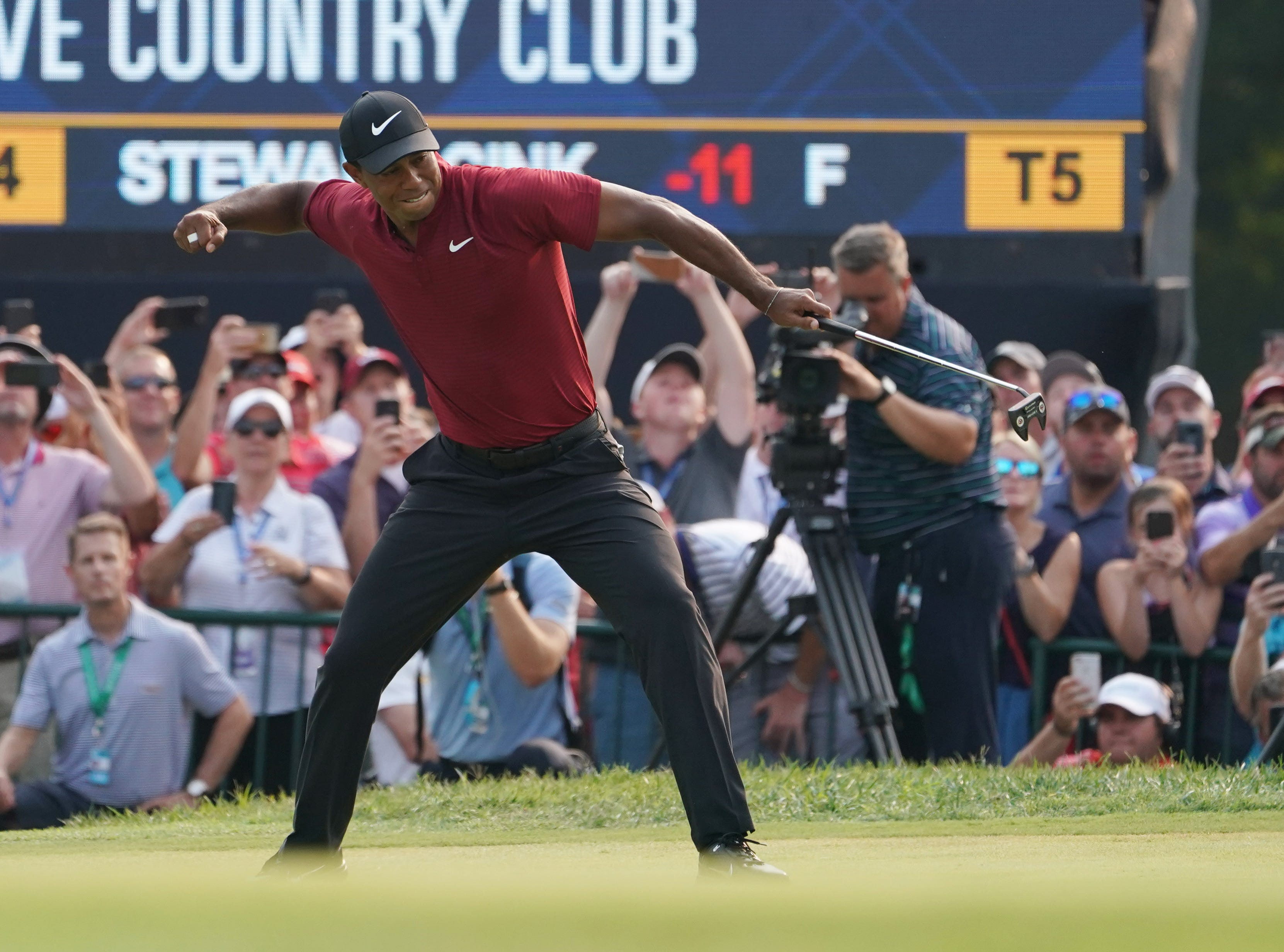 Woods closes with a 64 in the PGA Championship at Bellerive on Aug. 12, 2018 – his lowest round in a major – but Brooks Koepka keeps his cool and wins by two shots. Here Woods celebrates after making a birdie putt on the 18th green.