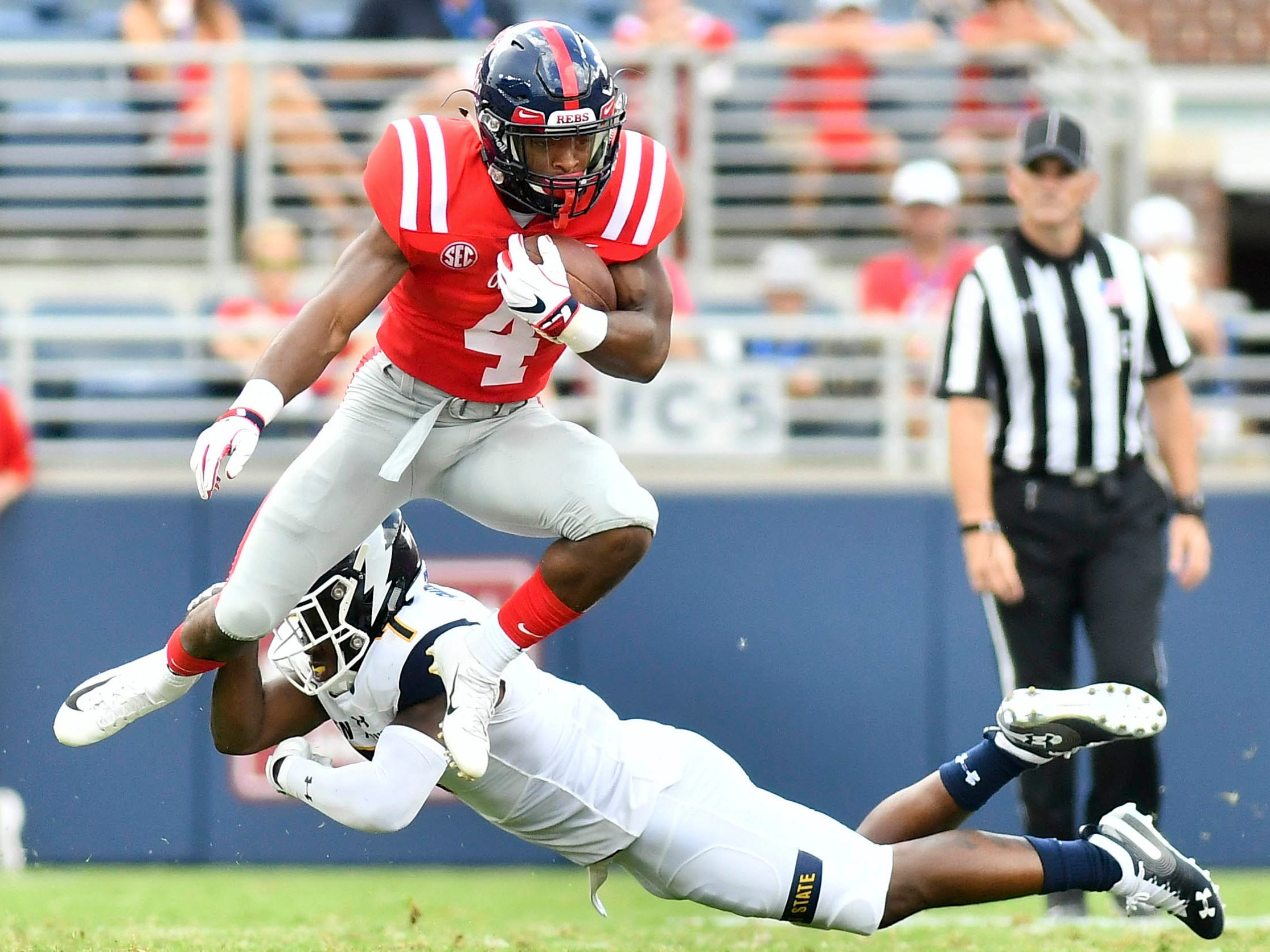 Mississippi Rebels running back Tylan Knight avoids a tackle by Kent State Golden Flashes cornerback Jamal Parker during the second quarter at Vaught-Hemingway Stadium.