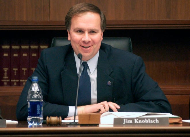 In this Jan. 30, 2003 file photo Republican state Rep. Jim Knoblach attends a meeting in the State Office Building in St. Paul, Minn.