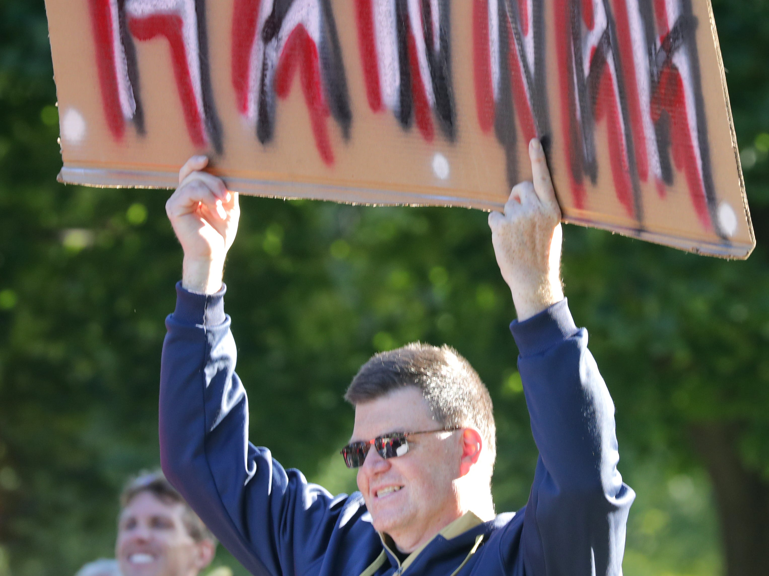 Brian Still cheers at the finish line during the 28th annual Community First Fox Cities Marathon on Sunday, September 23, 2018, in Neenah Wis. Wm. Glasheen/USA TODAY NETWORK-Wisconsin.