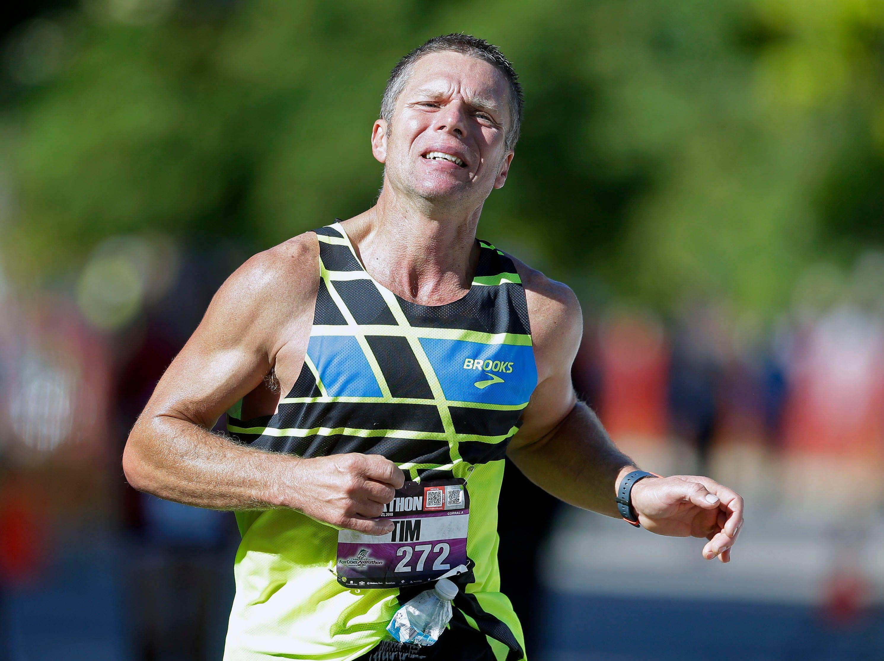 Tim Maass finishes the Community First Fox Cities Marathon Sept. 23, 2018, across the Fox Cities.