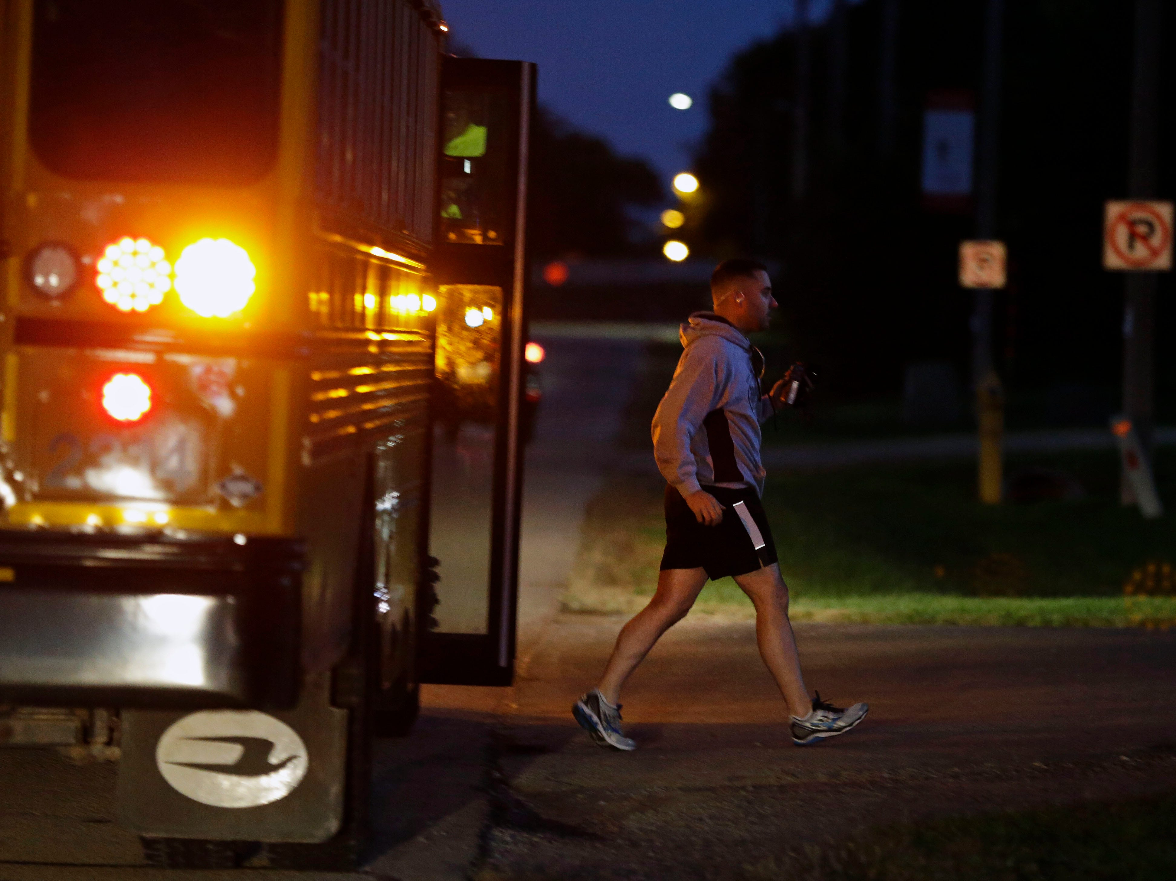 A bus drops off runners at the start as the Community First Fox Cities Marathon takes place Sunday, September 23, 2018, across the Fox Cities.
