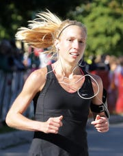 Kathy Derks, a Hortonville High School graduate, was the top female finisher in the Fox Cities Marathon on Sunday.