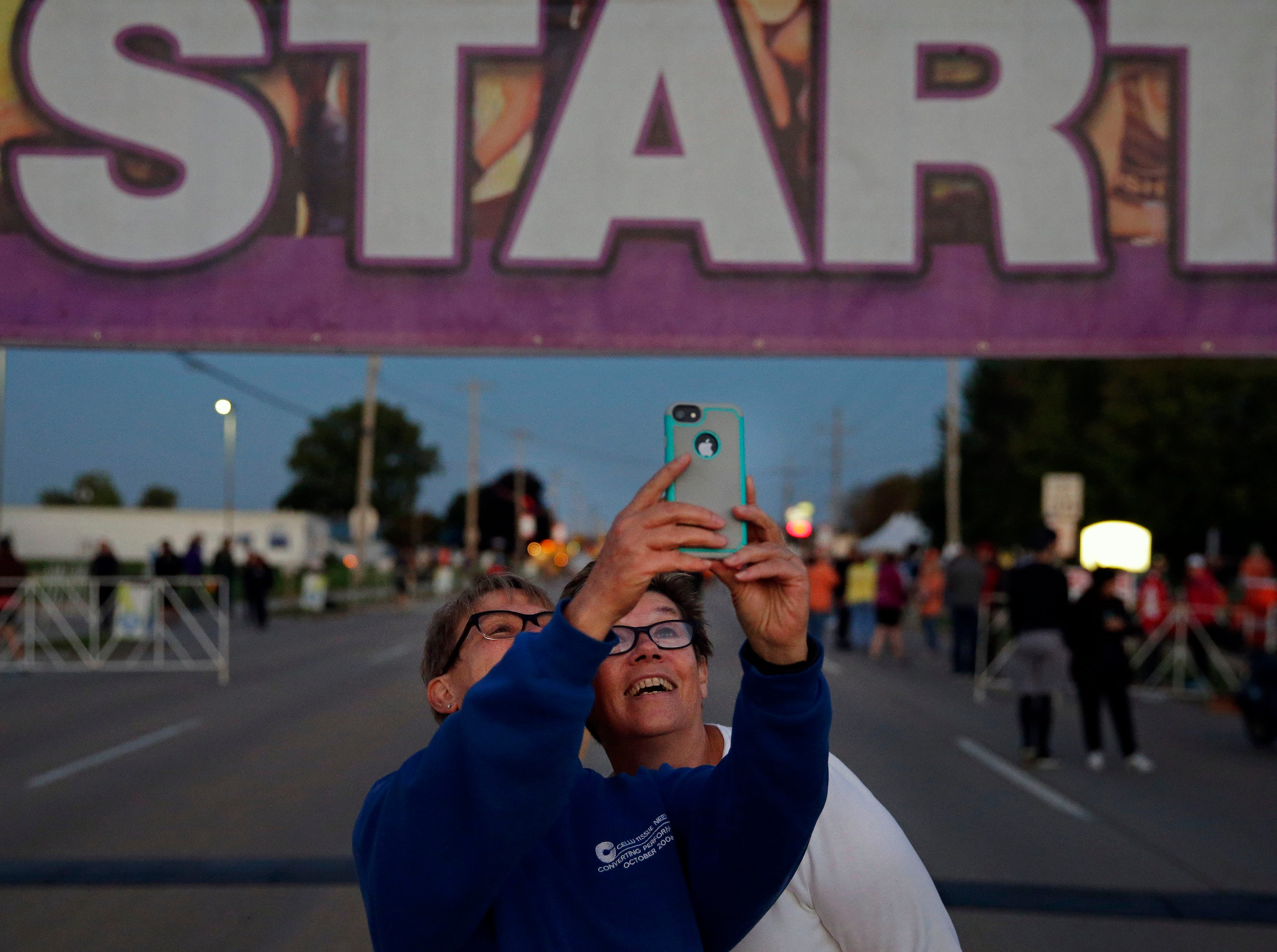 Christine Dancker, left, and JoAnn Burgett get a photo before the start of the Community First Fox Cities Marathon Sunday, September 23, 2018, across the Fox Cities.