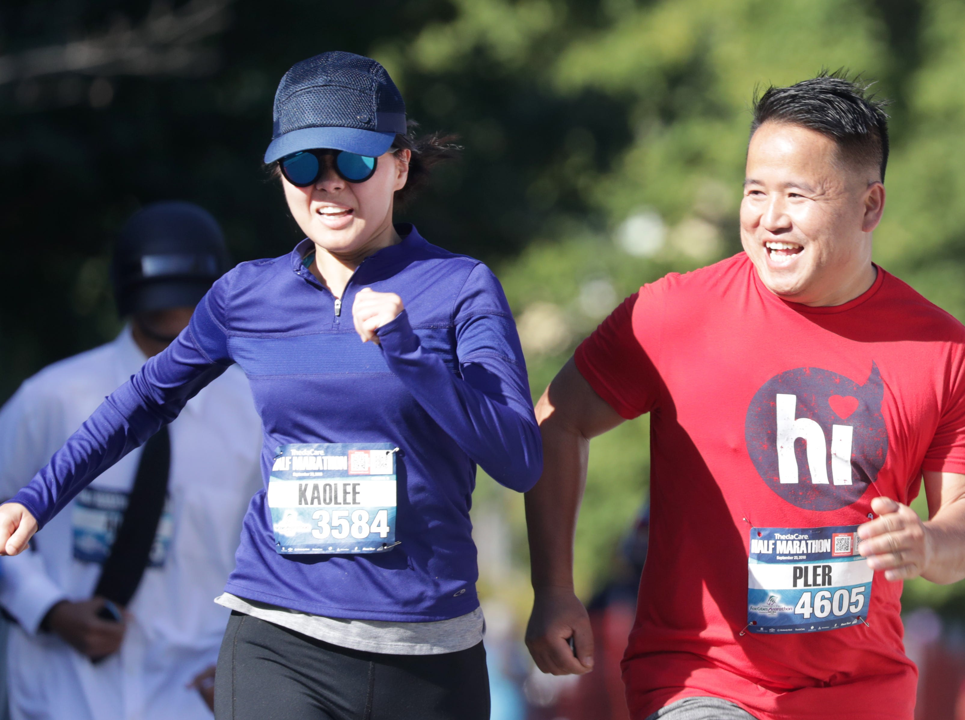 Kaolee Hoyle and Pler Yang crosse the finish line in the half marathon event during the 28th annual Community First Fox Cities Marathon on Sept. 23, 2018, in Neenah, Wis.