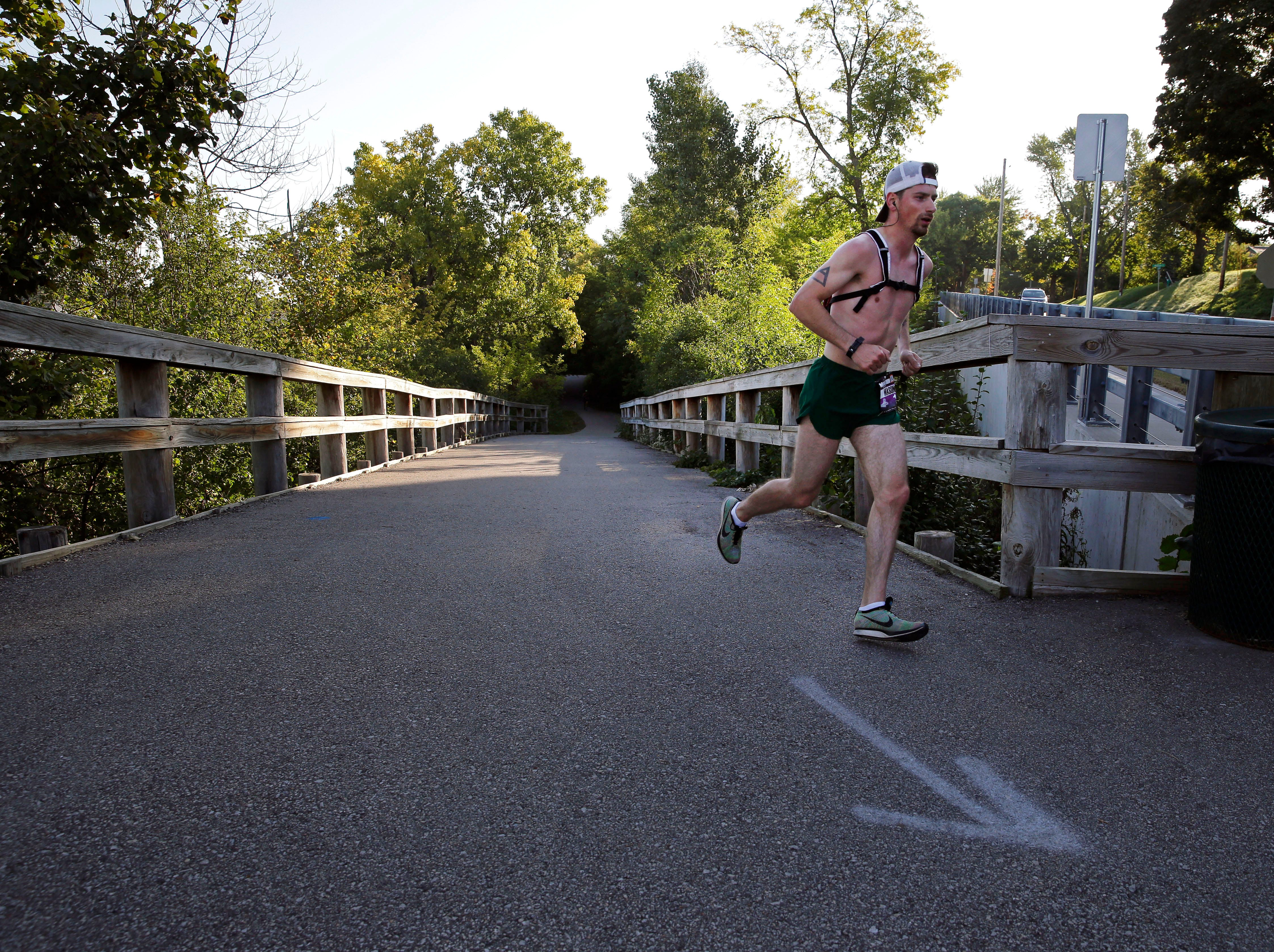 Mason Grundy has the lead as he comes off the Newberry Trail during the Community First Fox Cities Marathon Sept. 23, 2018, across the Fox Cities.