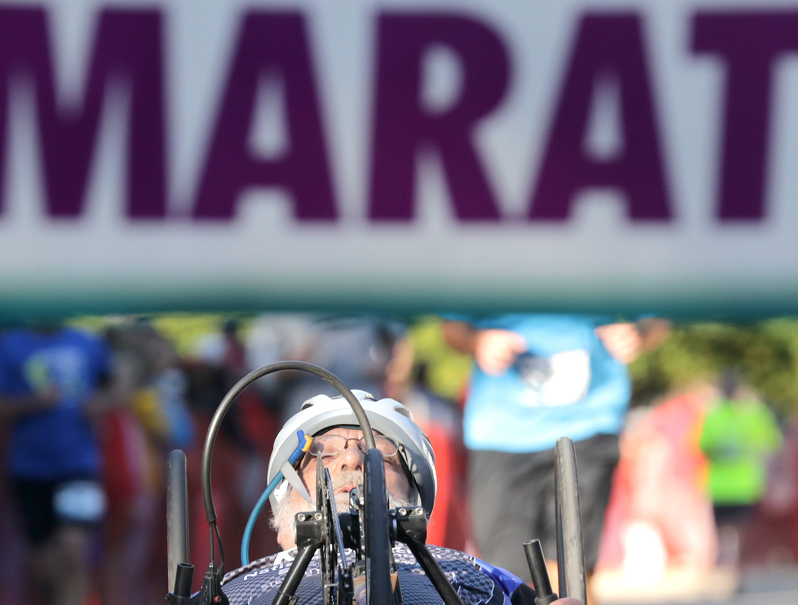 Ron Malik crosses the finish line wheel chair/ hand crank in the marathon event during the 28th annual Community First Fox Cities Marathon on Sunday, September 23, 2018, in Neenah Wis. Wm. Glasheen/USA TODAY NETWORK-Wisconsin.