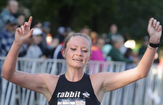 Michele Lee was the top female finisher in the ThedaCare Half Marathon on Sunday despite running a little more than 13.1 miles.