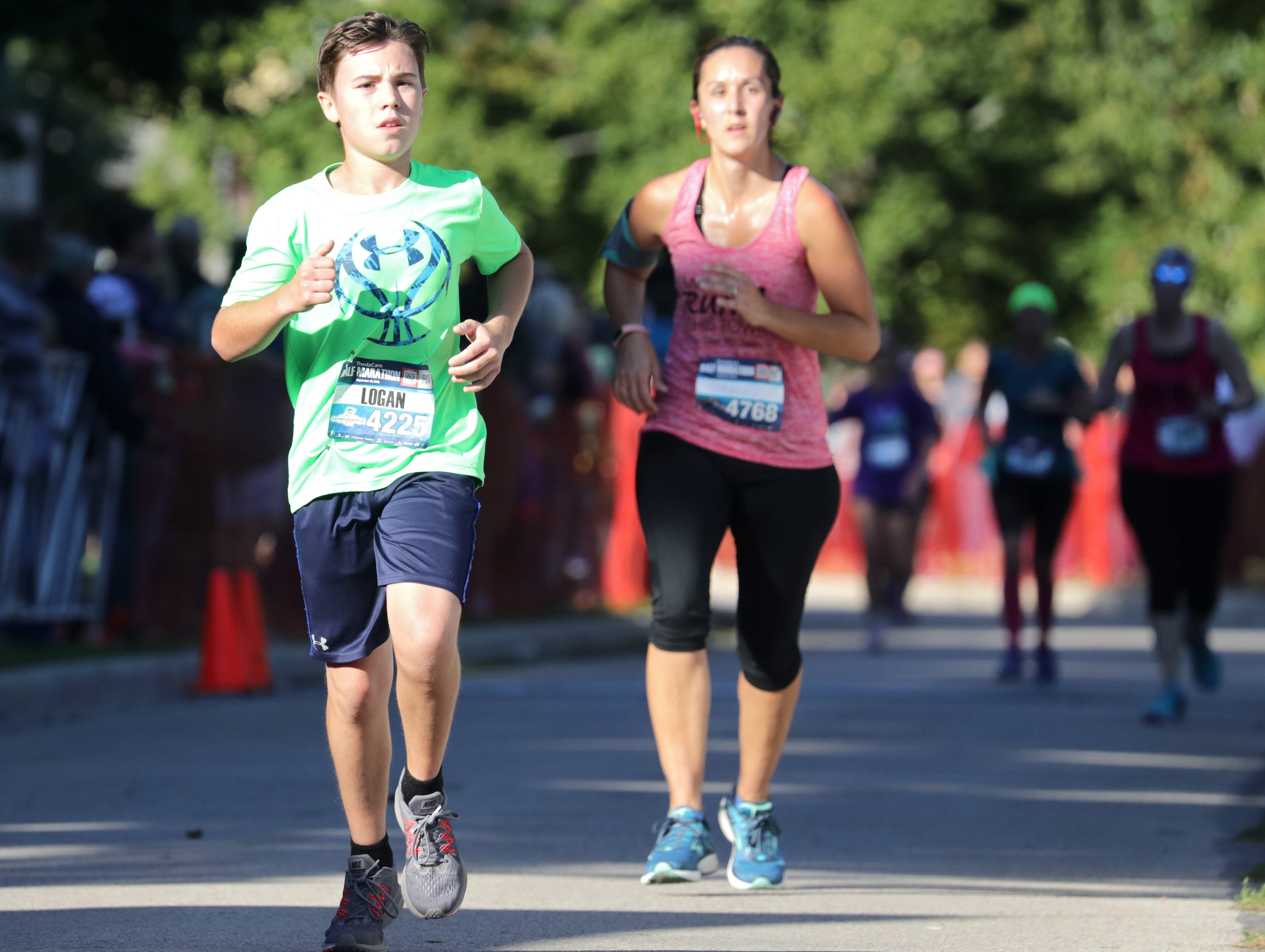 Logan Schmitz crosses the finish line in the half marathon event during the 28th annual Community First Fox Cities Marathon on Sunday, September 23, 2018, in Neenah Wis. Wm. Glasheen/USA TODAY NETWORK-Wisconsin.