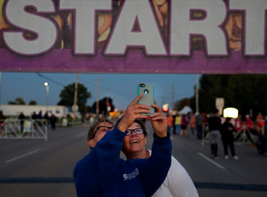 Christine Dancker, left, and JoAnn Burgett get a photo before the start of the Community First Fox Cities Marathon on Sunday.