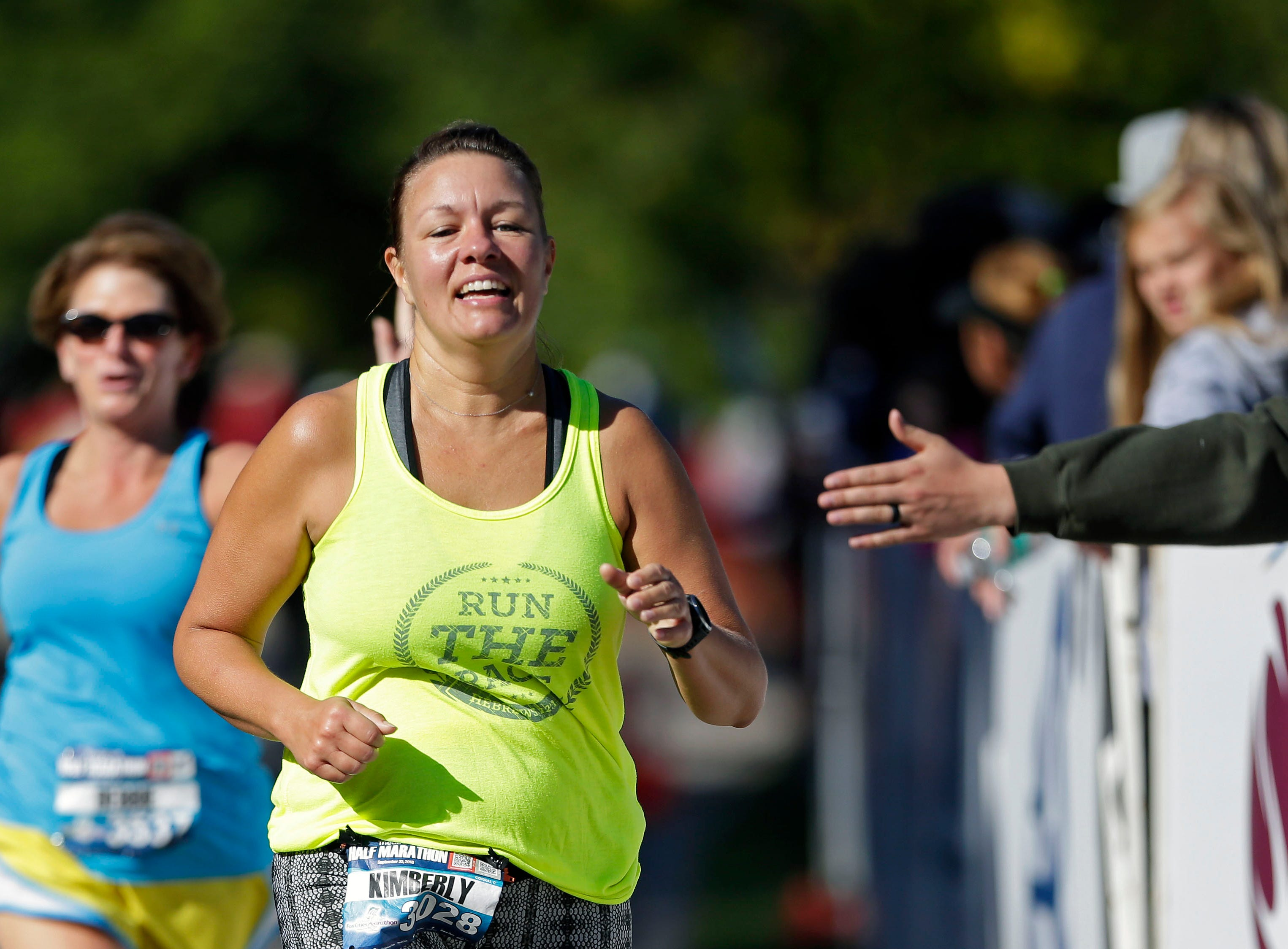 Kimberly Ansorge nears the finish as the Community First Fox Cities Marathon takes place Sept. 23, 2018, across the Fox Cities.